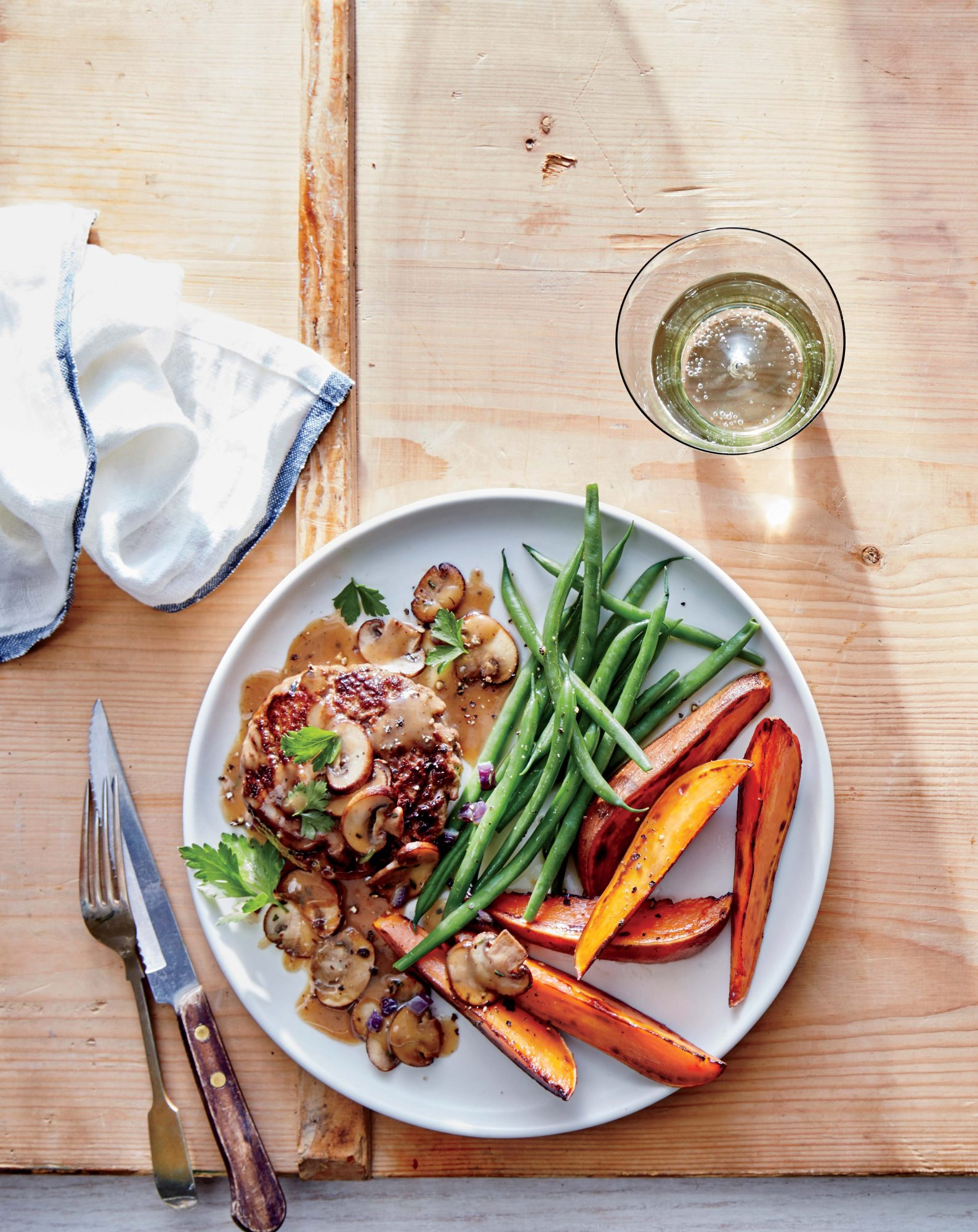 Burger Steaks with Mushroom Gravy, Sweet Potato Wedges, and Haricots Verts Image