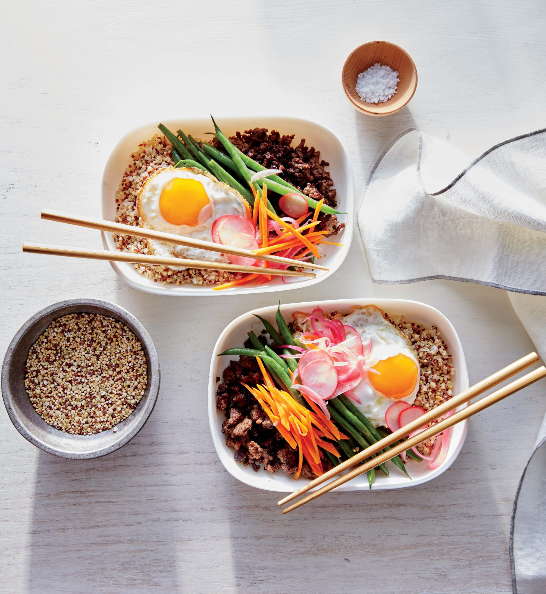 """Quinoa Bibimbop Bowls                            RecipeBibimbop is a Korean dish that means """"mixed rice."""" For this version, we took a hearty grain like quinoa and served it with crunchy vegetables and a fried egg. Let the family build their own bowls, so this way, everyone's happy."""