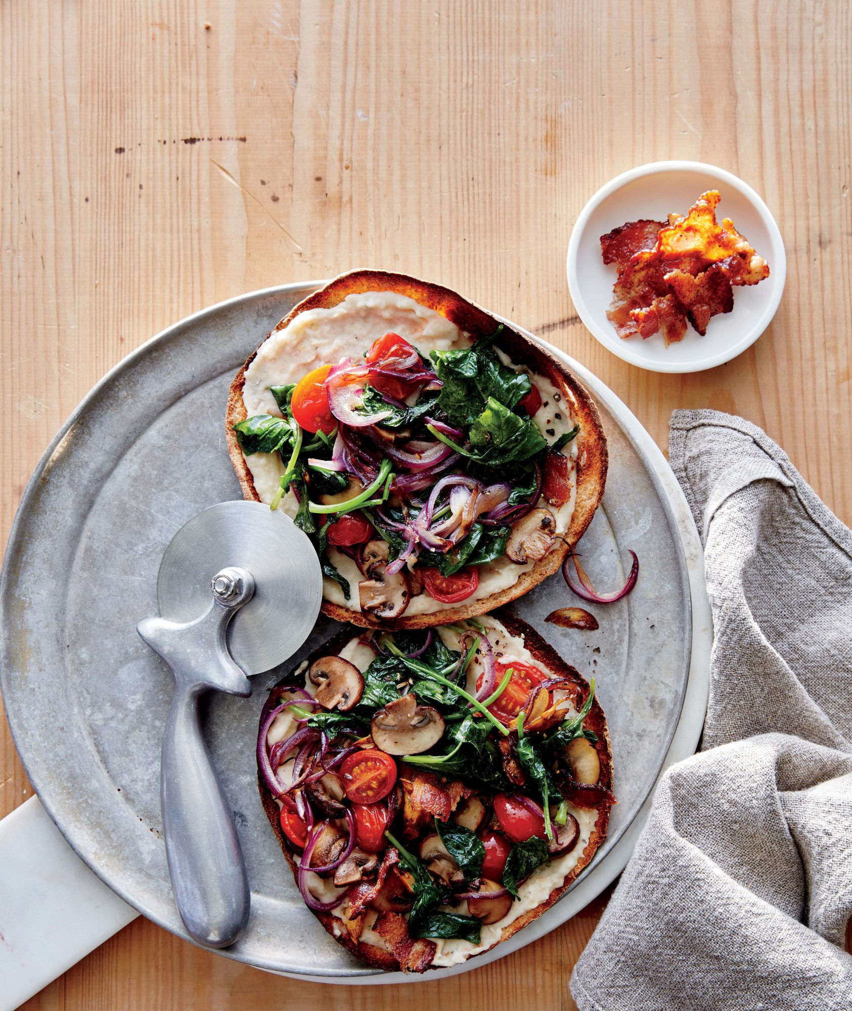 Kale, Mushroom, and Bacon Pita Pizzas Image