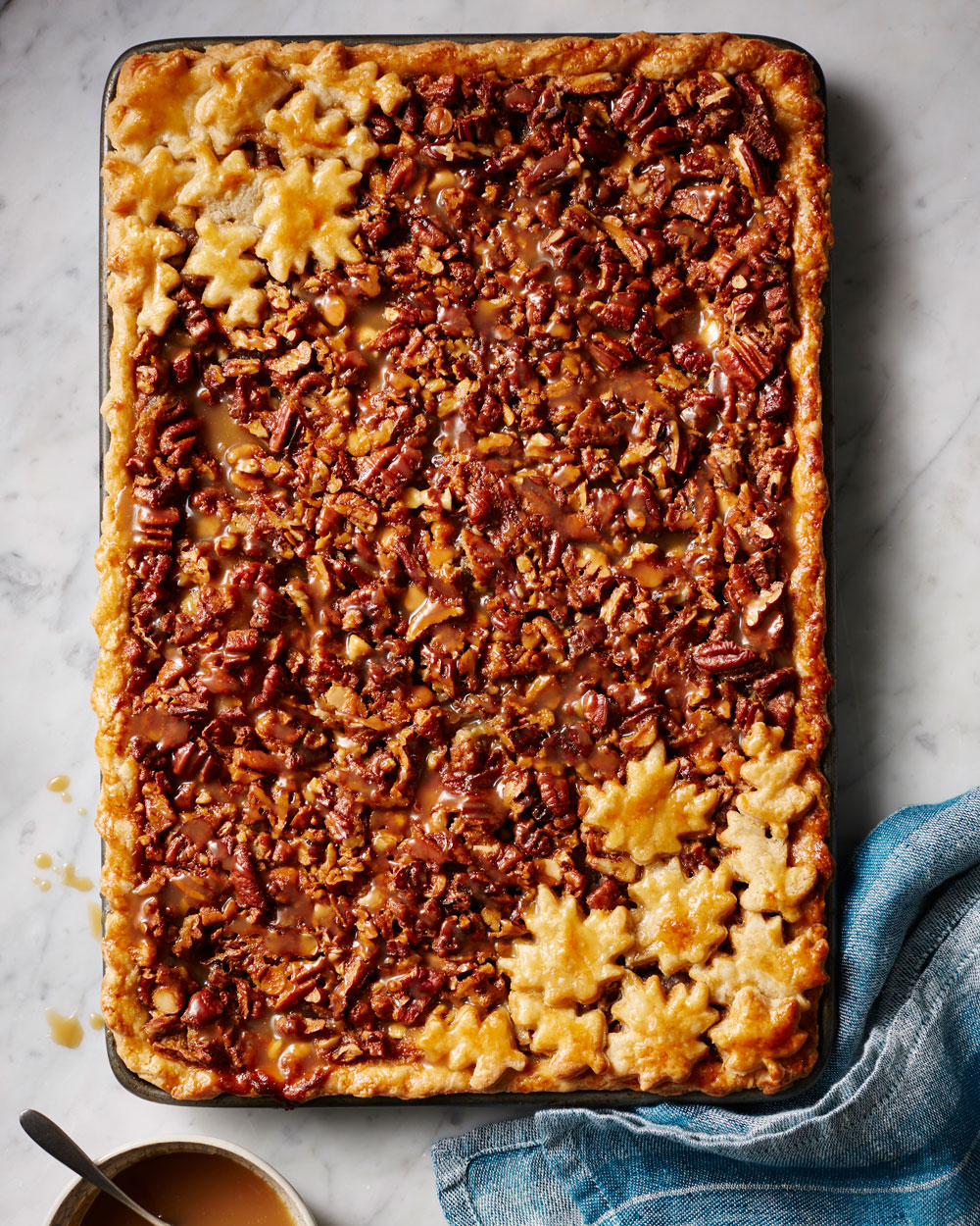 <p>White Chocolate and Bourbon Pecan Slab Pie with Caramel Sauce</p>