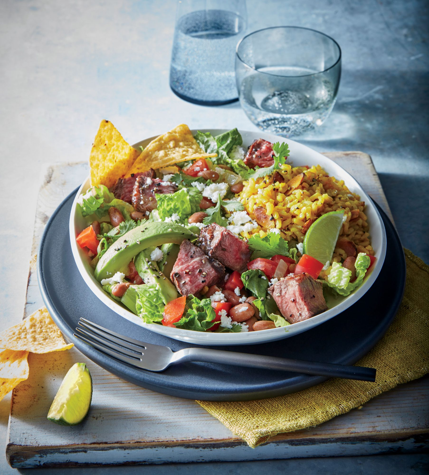 Carne Asada Bowls                            RecipeInstead of a fried shell, crunchy tortilla chips mingle in a base of crisp, sturdy romaine. Serve with rice.