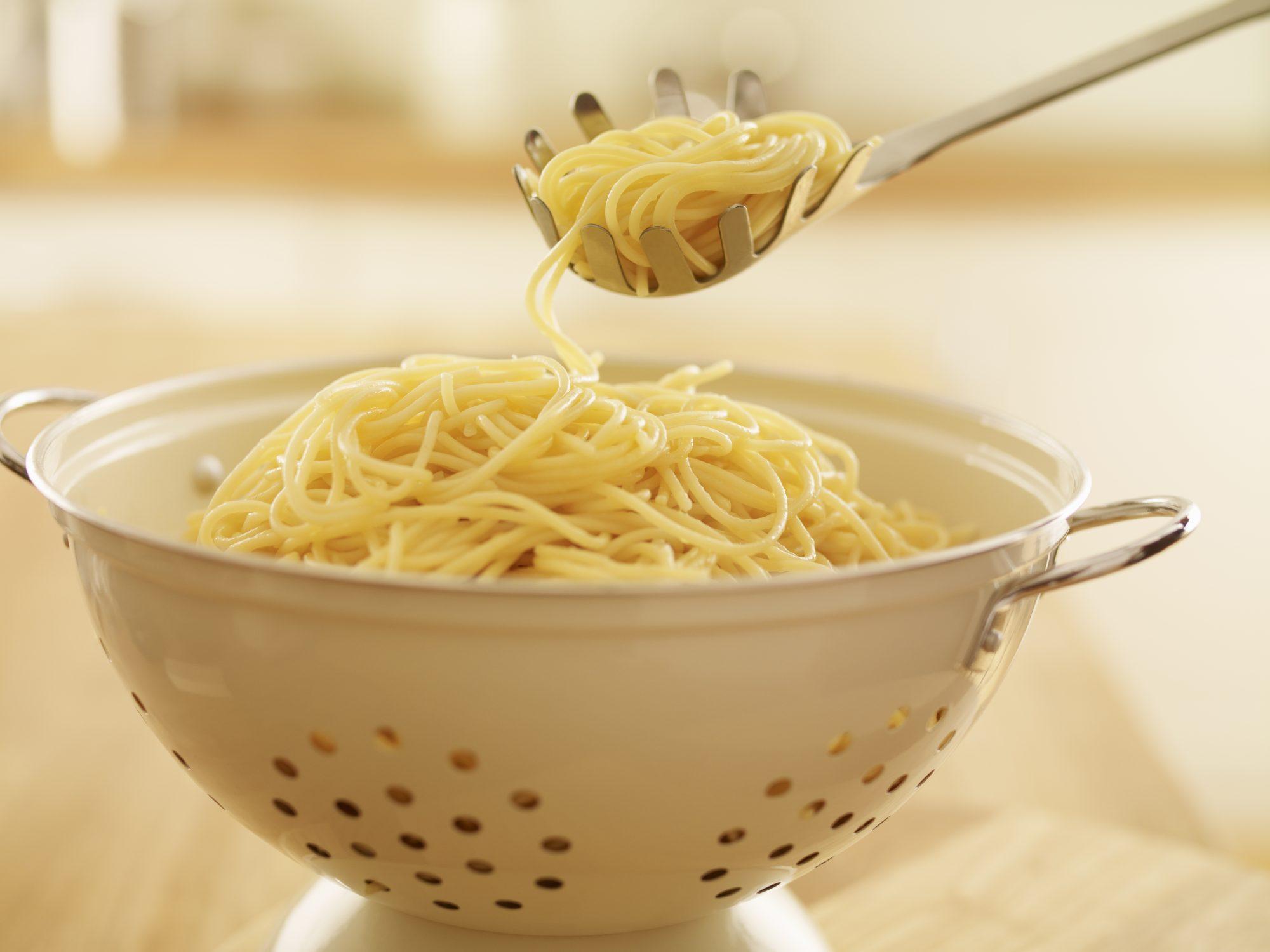 spaghetti in colander