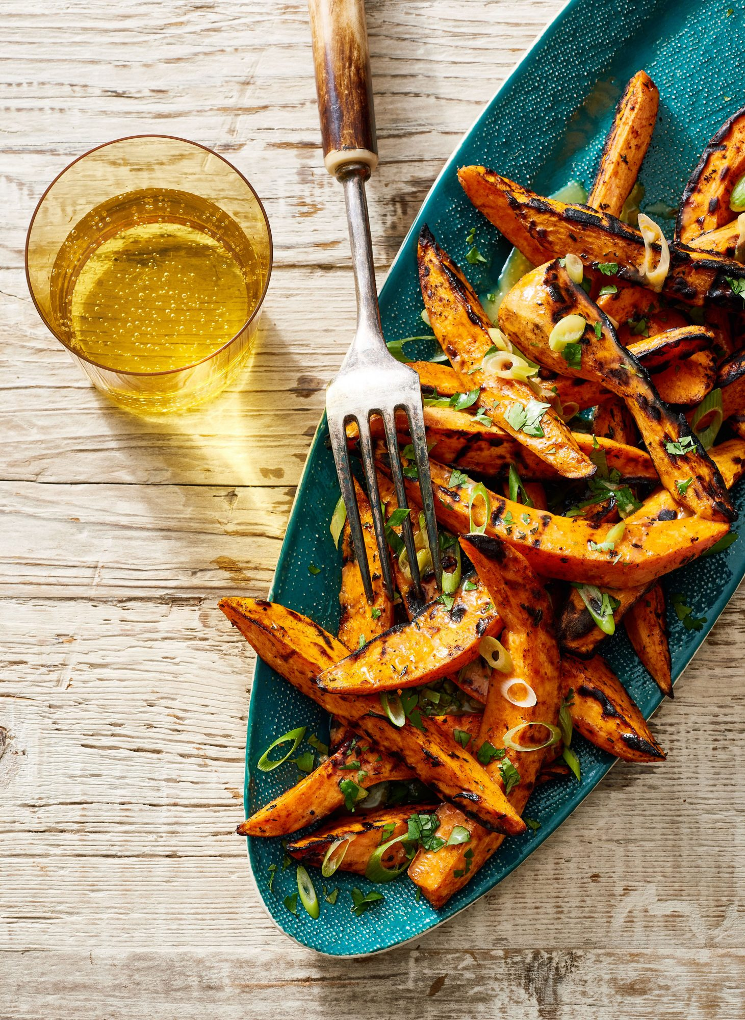 Grilled Sweet Potatoes with Scallion Butter Recipe | MyRecipes