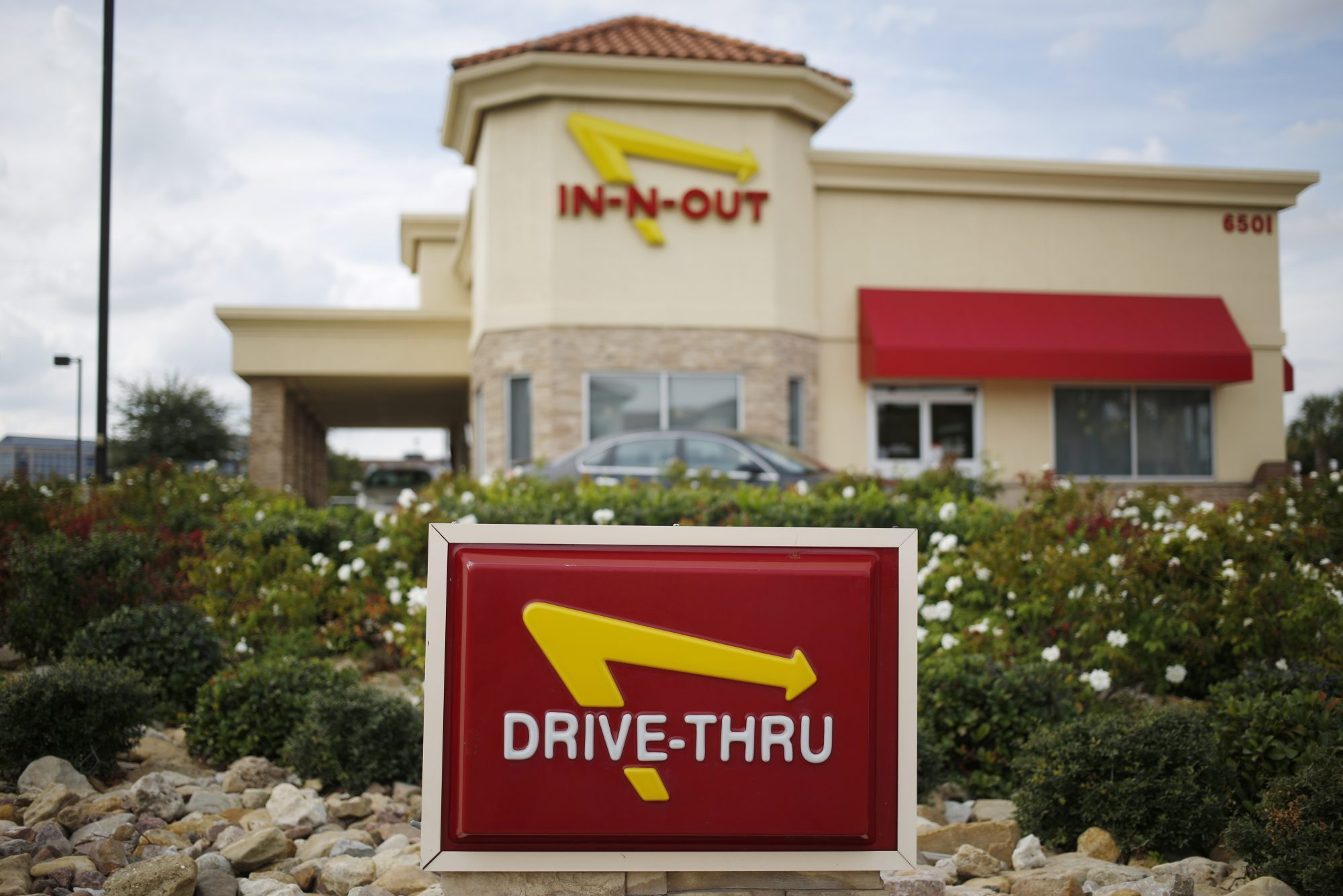 A drive-thru sign is displayed outside of a In-N-Out Burger restaurant in Dallas, Texas, U.S., on Tuesday, Oct. 25, 2016. Good Food Institute has started a petition to pressure In-N-Out Burger to offer meatless options on its menu. Photographer: Luke Shar