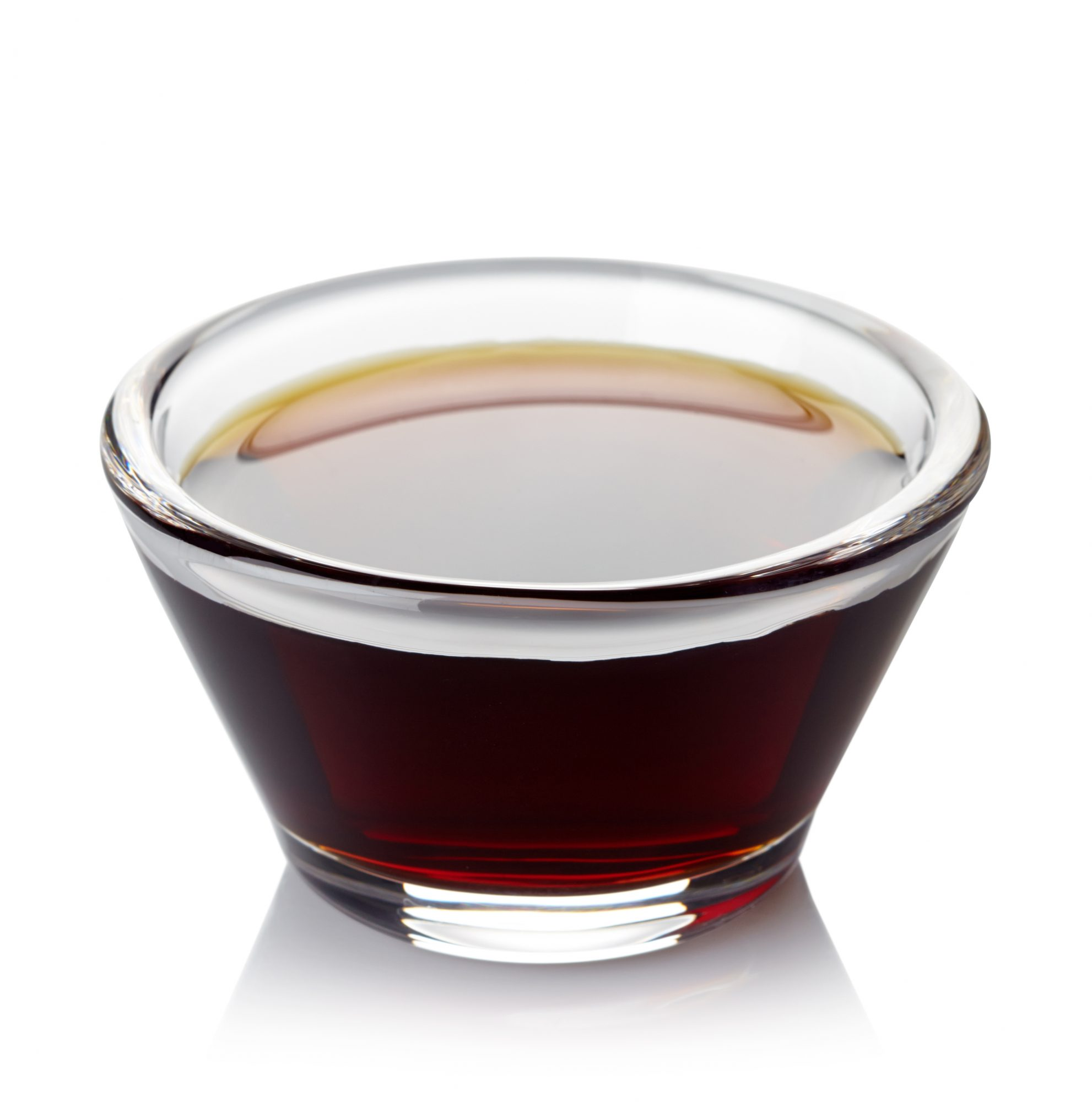 Bowl of soy sauce isolated on white background