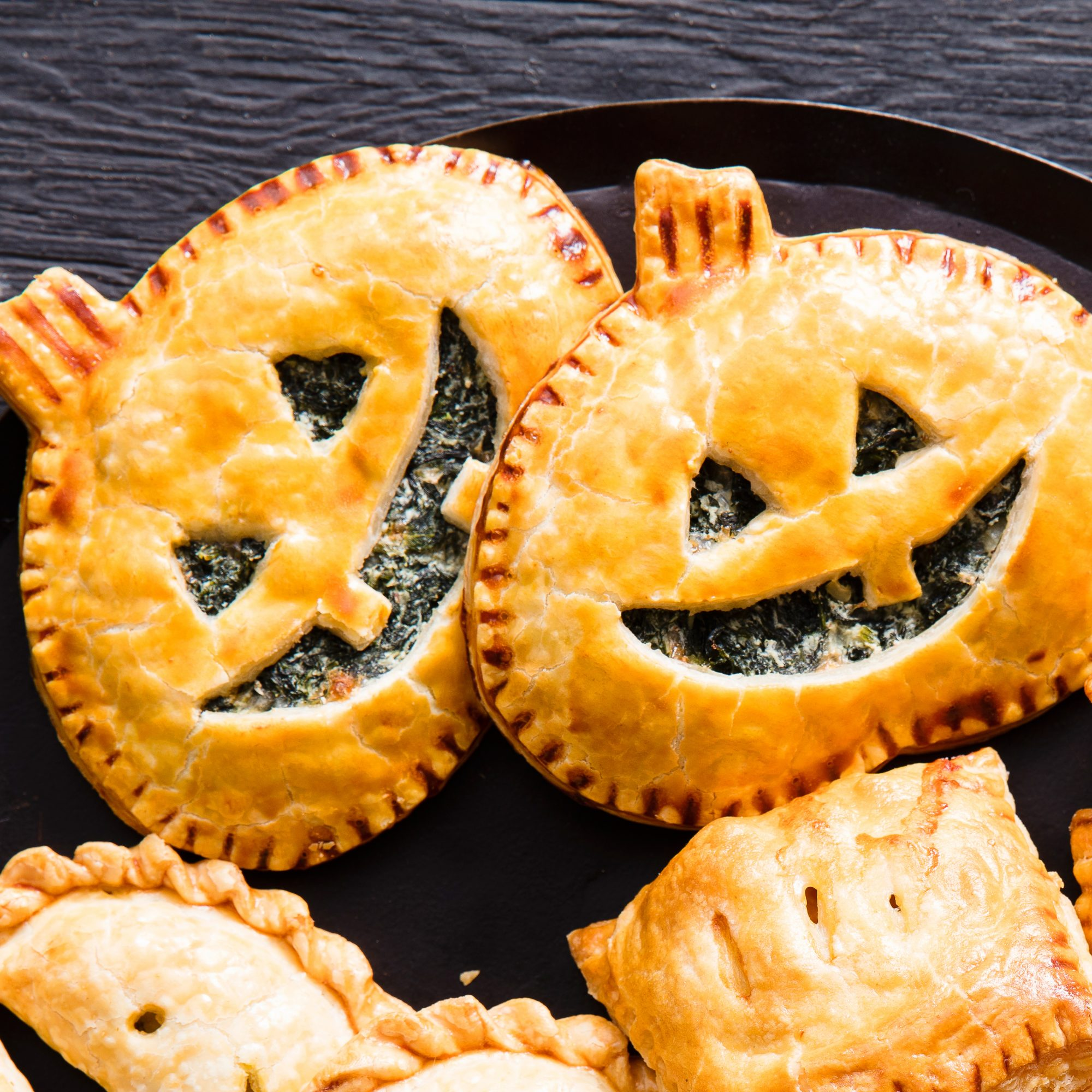 spinach jack o lantern hand pies