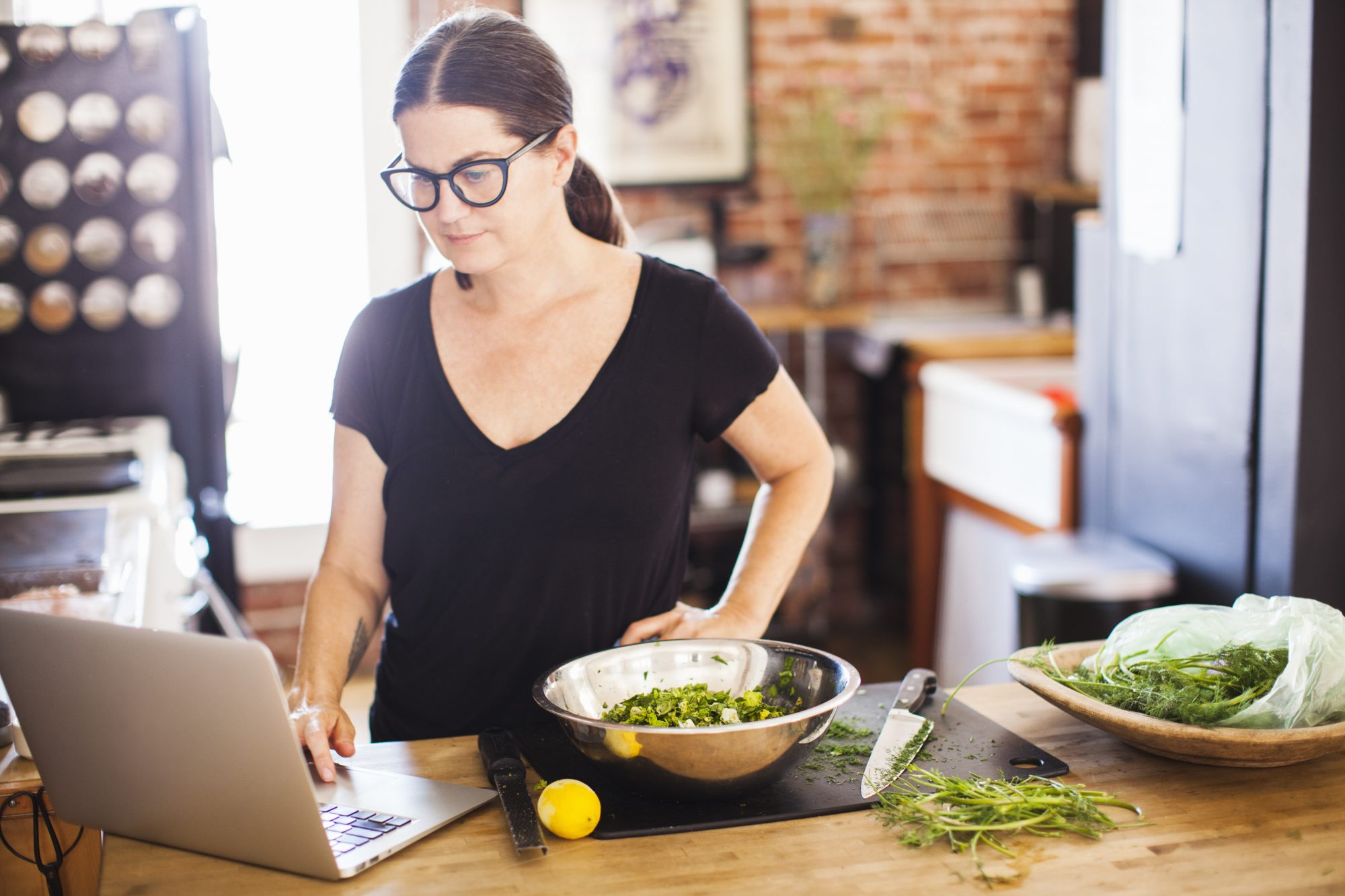 getty-woman-cooking-with-laptop-image