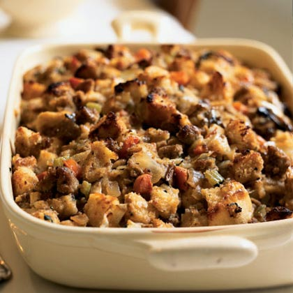 Sourdough Stuffing with Pears and Sausage RecipeYou might be tempted to leave off the turkey in place of this hearty sourdough bread stuffing that's packed with carrot, celery, onion, mushrooms, and turkey sausage.  Chopped fresh pears adds just a note of subtle sweetness to the savory dish.