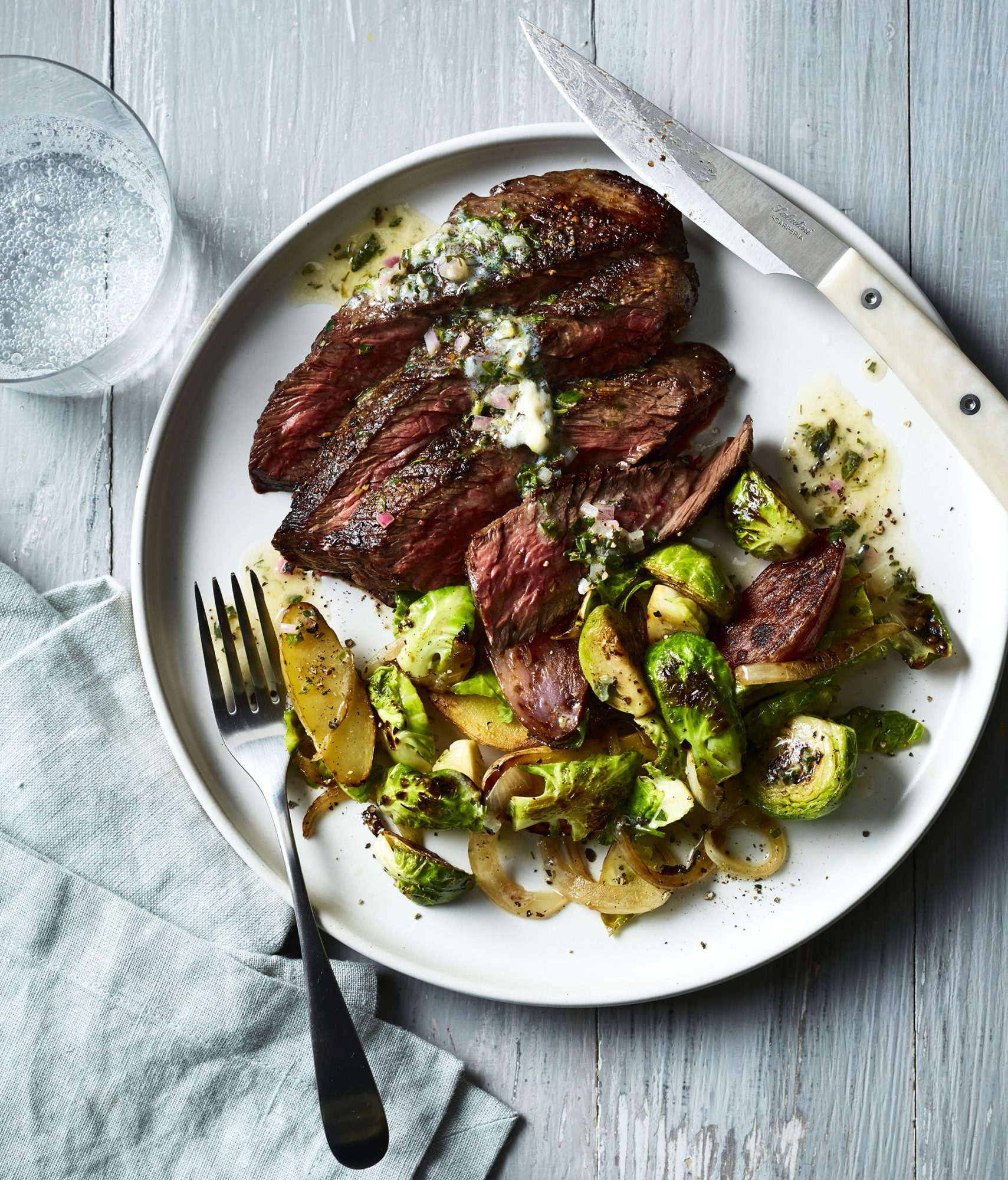 Pan Seared Hanger Steak with Brussels Sprouts, Potatoes, and Lemon-Herb Butter image