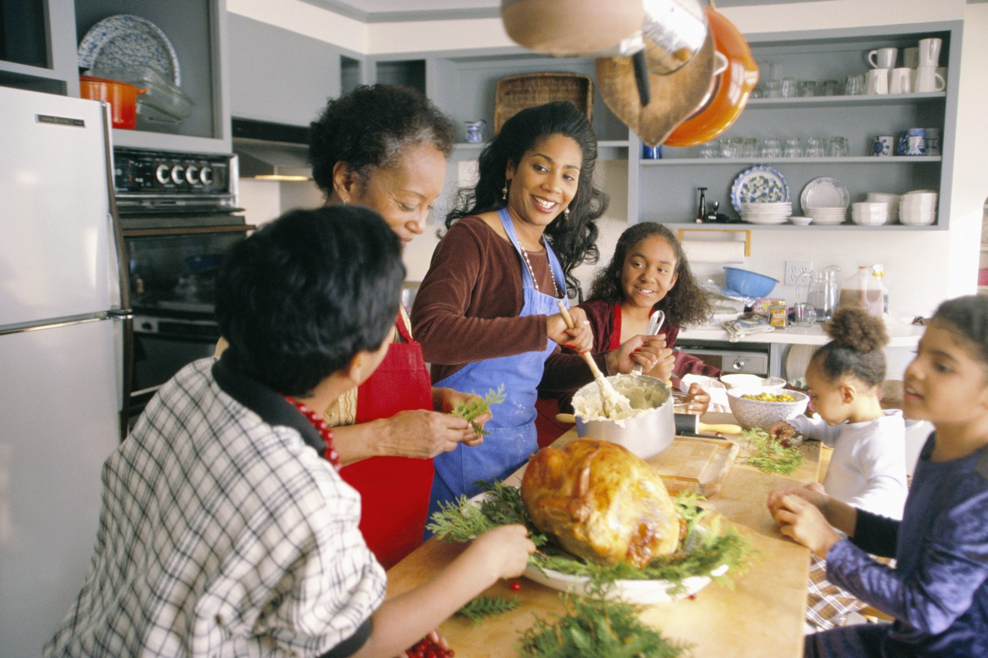 getty family preparing holiday dinner in the kitchen image
