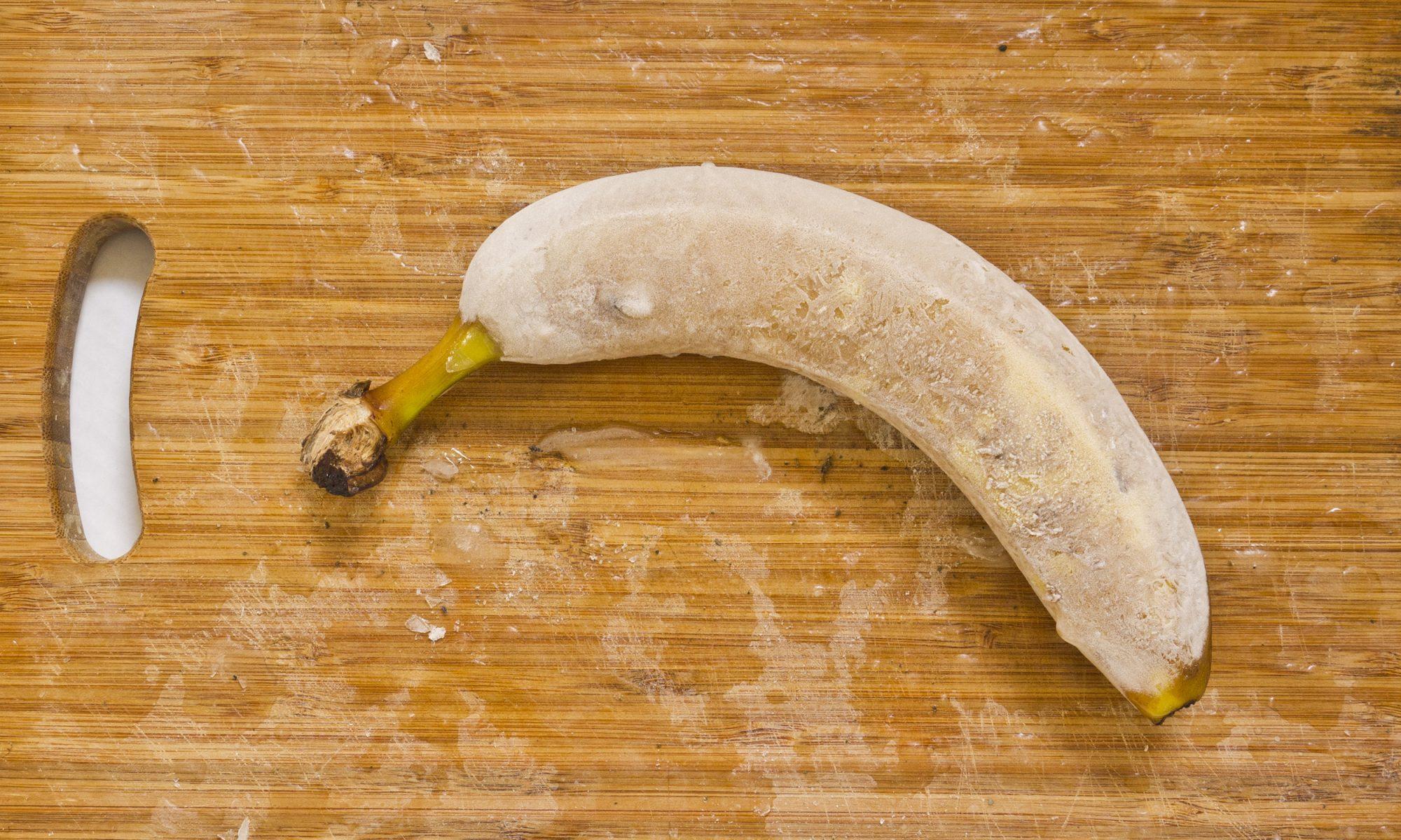 frozen banana on a cutting board