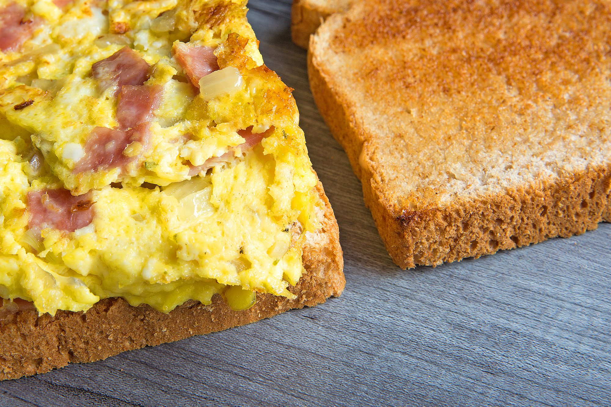 breakfast sandwich open face eggs and ham scrambled closeup