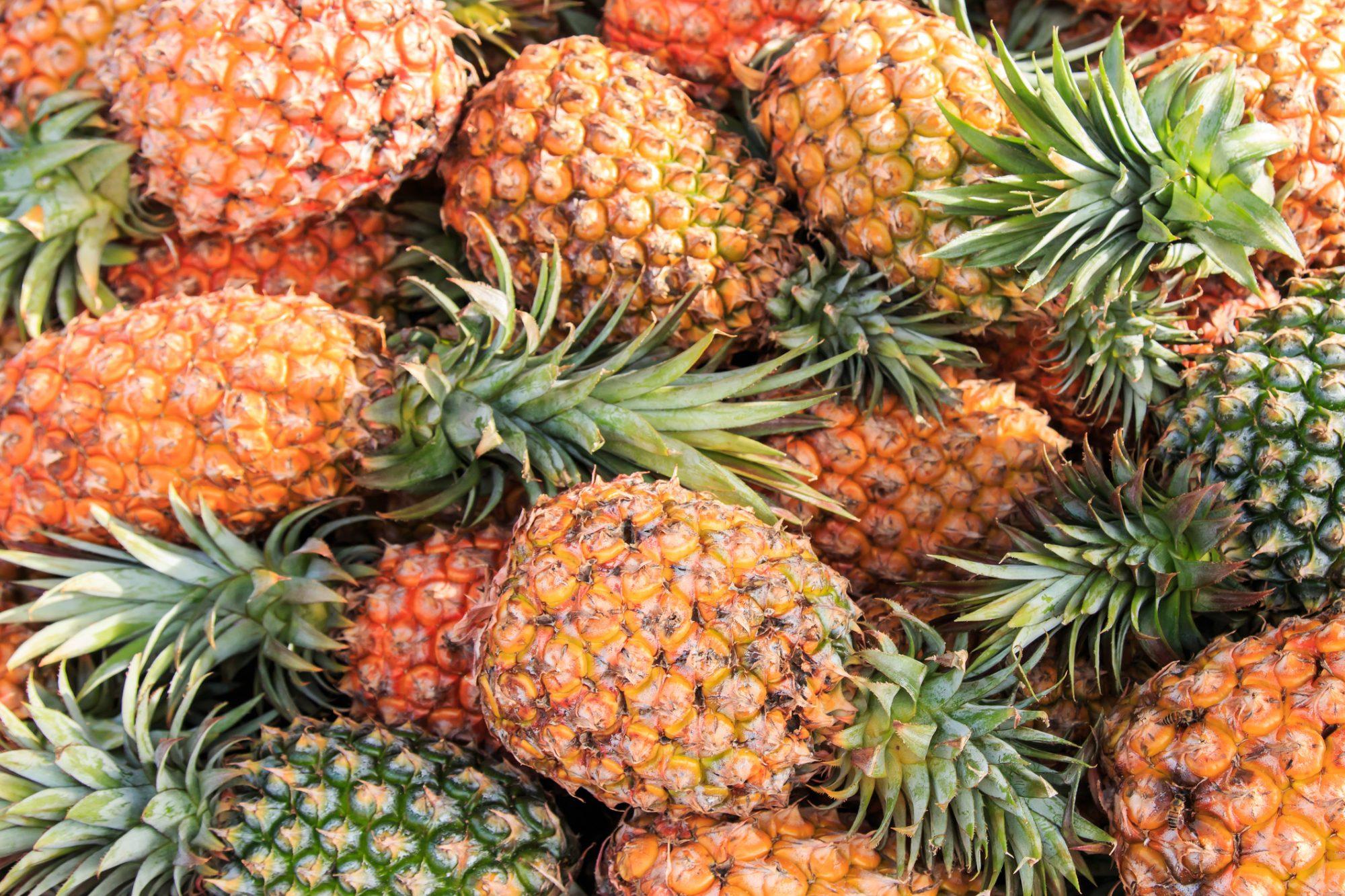 Full Frame Shot Of Pineapples For Sale At Market Stall