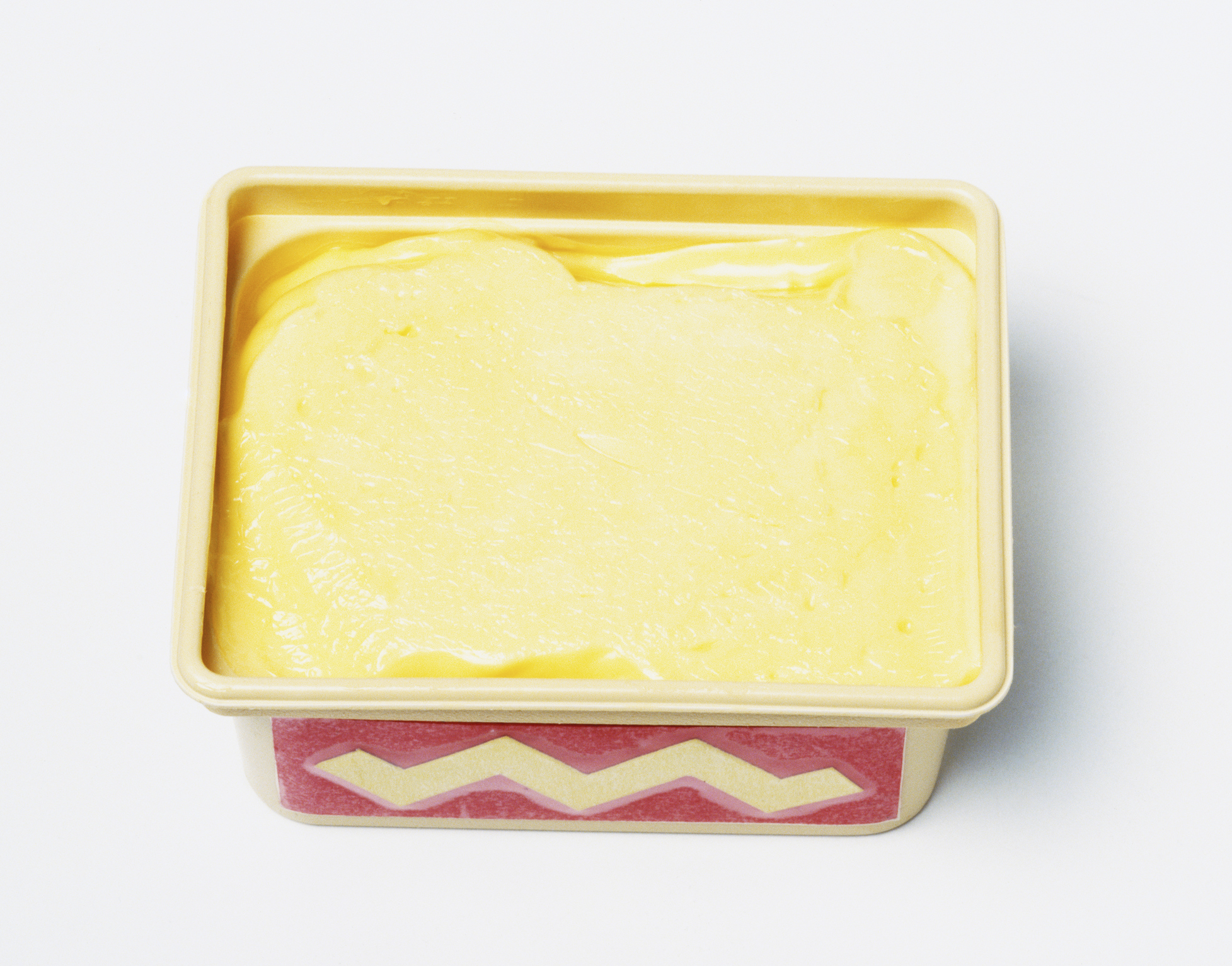 Tub of margarine with lid off, high angle view