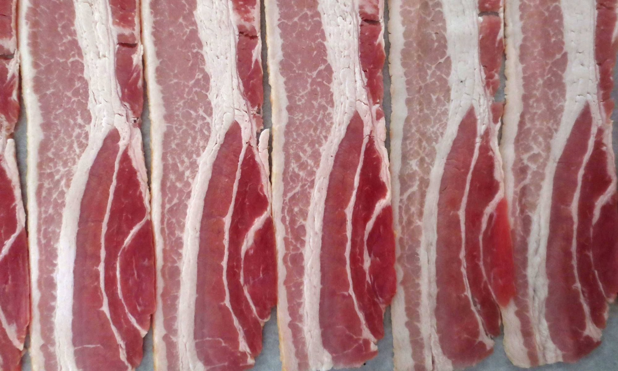 EC: Is Raw Bacon Safe to Eat?