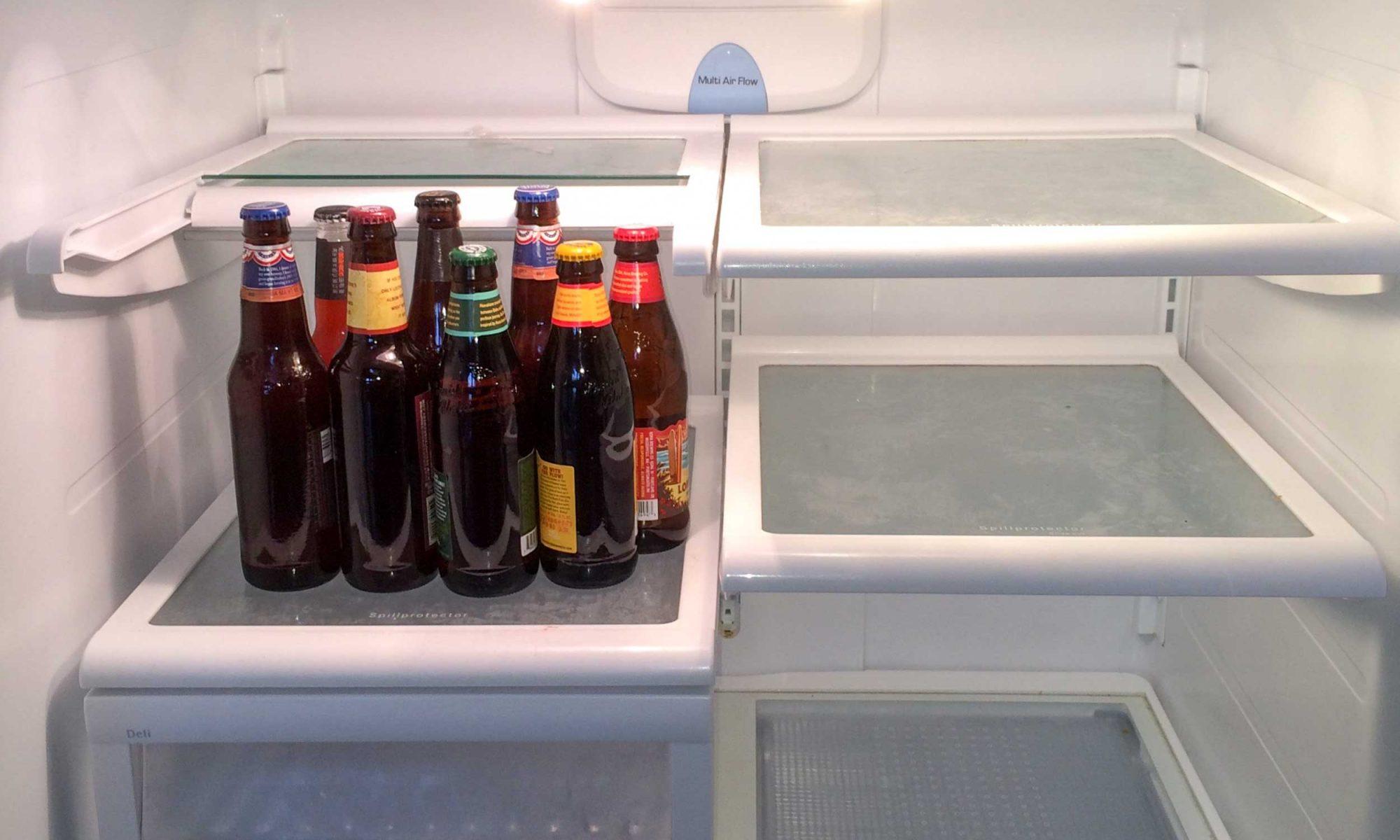 Bottles of beer in fridge
