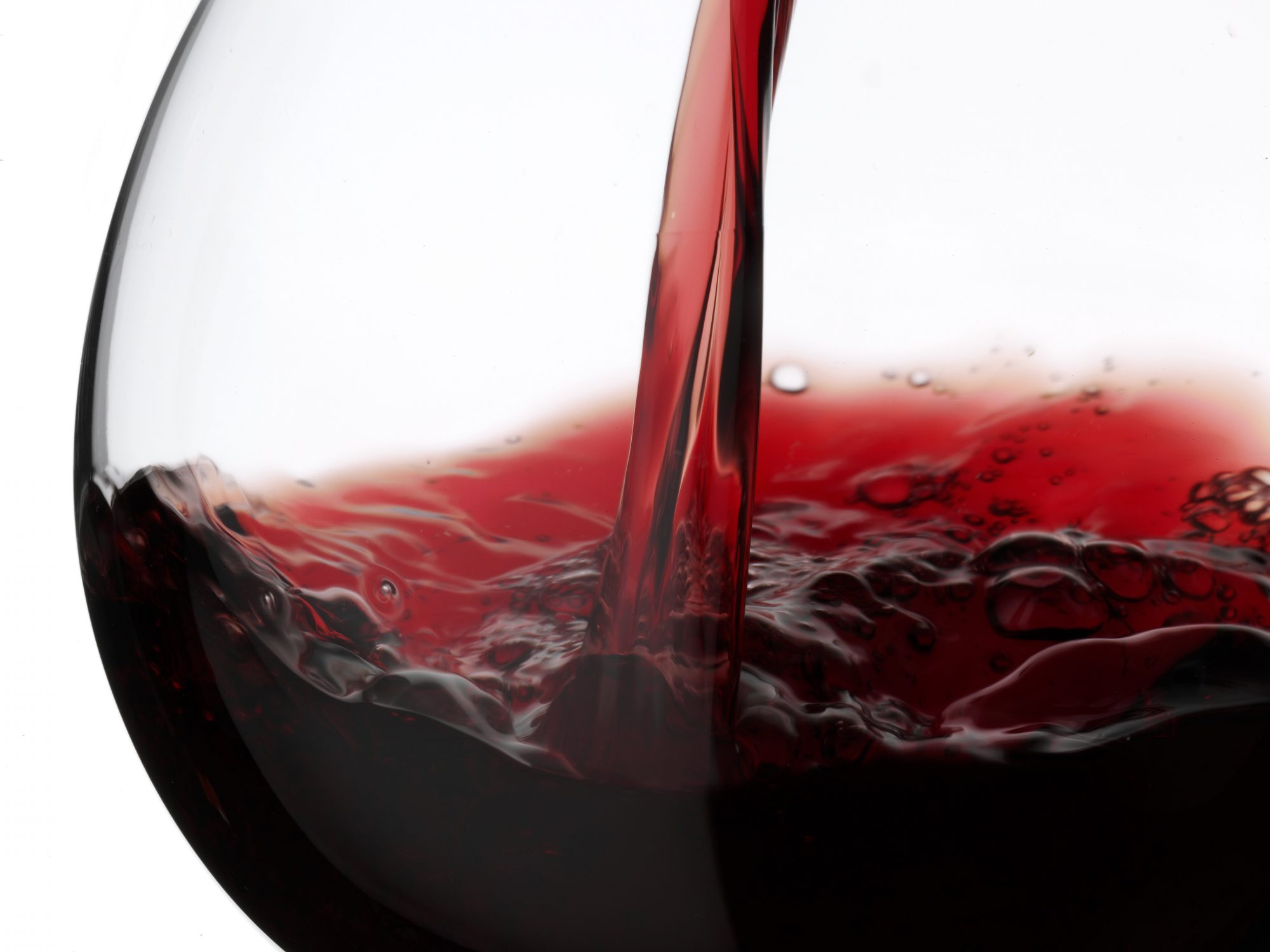 Close up of red wine pouring into glass
