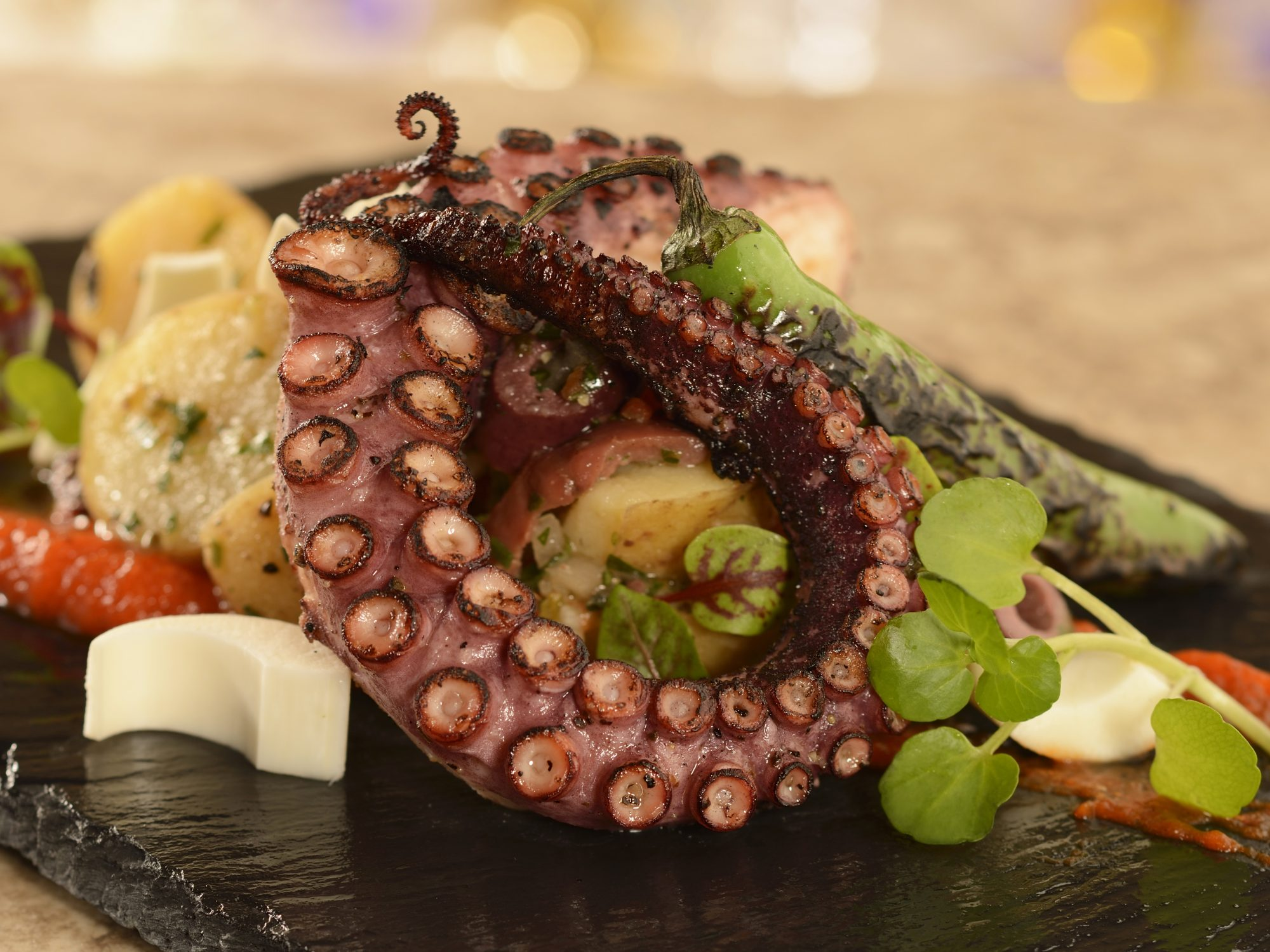 Disney World's 'Beauty and the Beast'-Themed Restaurant Menu Gets a Makeover This Summer disneyworld-be-our-guest-octopus-FT-BLOG0218