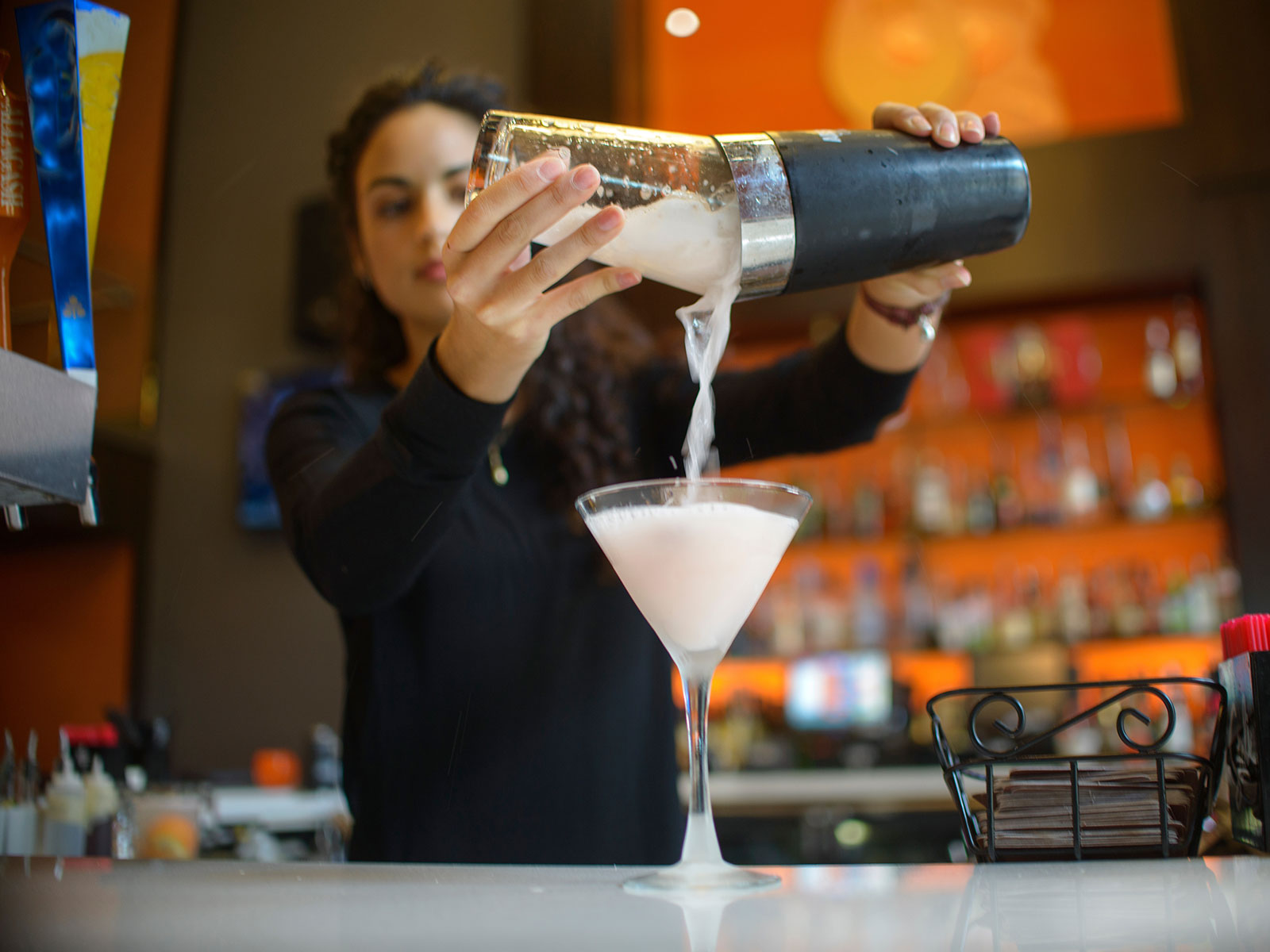 3 Sneaky Ways Bartenders Get You to Order More Drinks, According to a Pro
