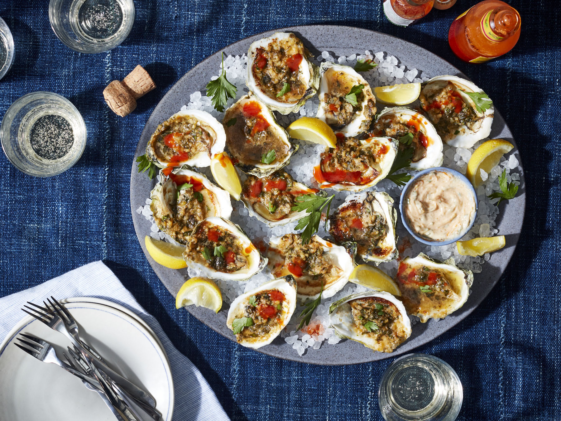 <p>Grilled Oysters with Garlic Butter</p>