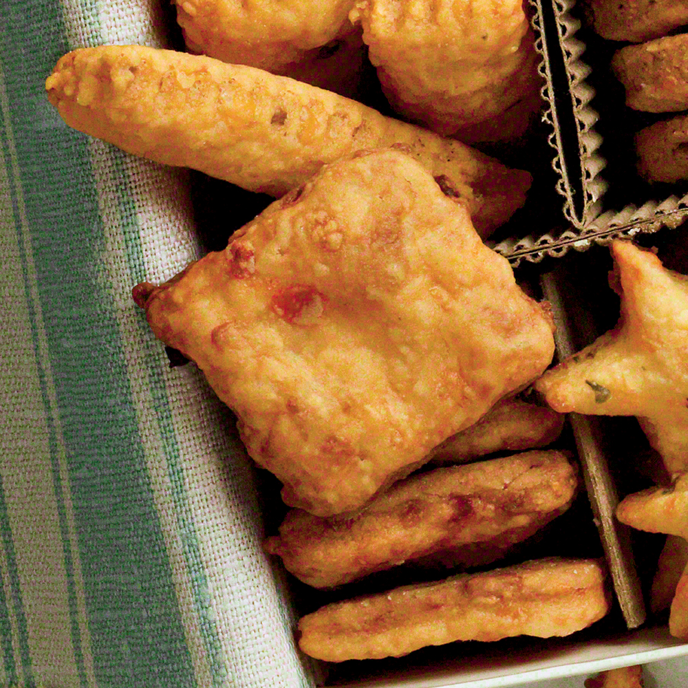 Pimiento Cheese Squares RecipeThe South's classic spread made into savory bites of Pimiento Cheese Squares makes the perfect appetizer for parties— a taste of home the crowd will love.
