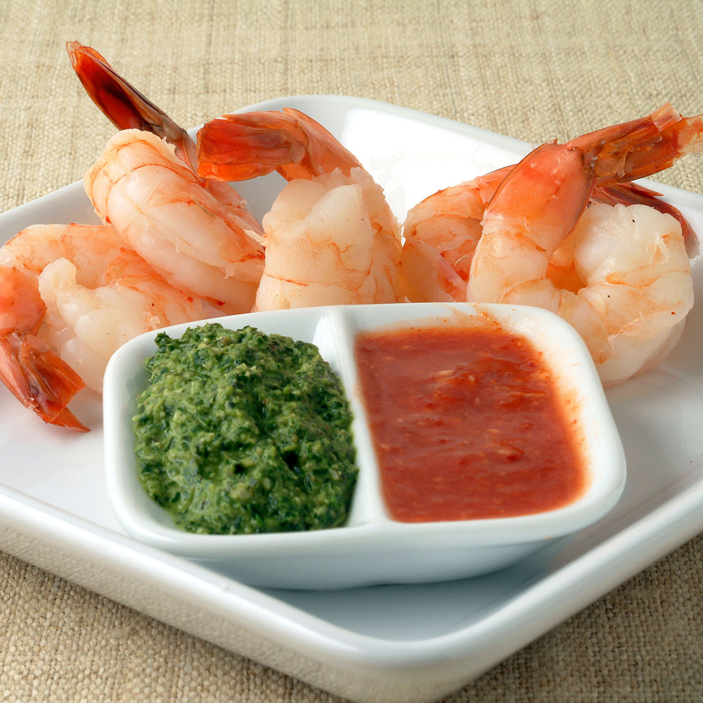 Classic Shrimp Cocktail with Red and Green Sauces RecipeThe tails of fresh shrimp beckon you to pick them up with your fingers and dip them into a savory sauce. If you need a few shortcuts, buy steamed shrimp at the seafood counter and use bottled green salsa and horseradish sauce instead of making your own.