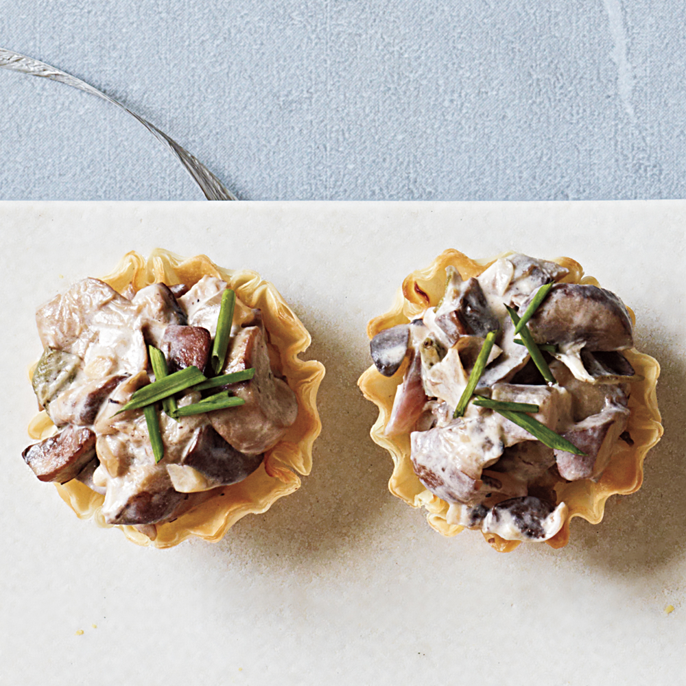 Mushroom and Goat Cheese Cups RecipeThe filling can be made and refrigerated up to a day in advance, then brought to room temperature before filling the cups. Phyllo shells come conveniently prebaked, so they're ready to fill once thawed.
