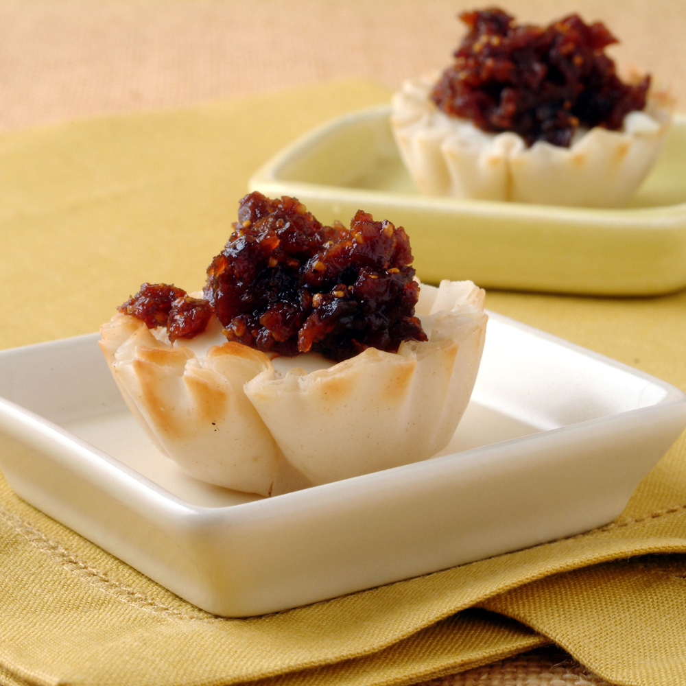 "Goat Cheese Tarts with Lemon-Fig Compote RecipeMini phyllo shells are definitely a ""go-to ingredient"" when you need to serve a sweet treat that doesn't require a fork or spoon."