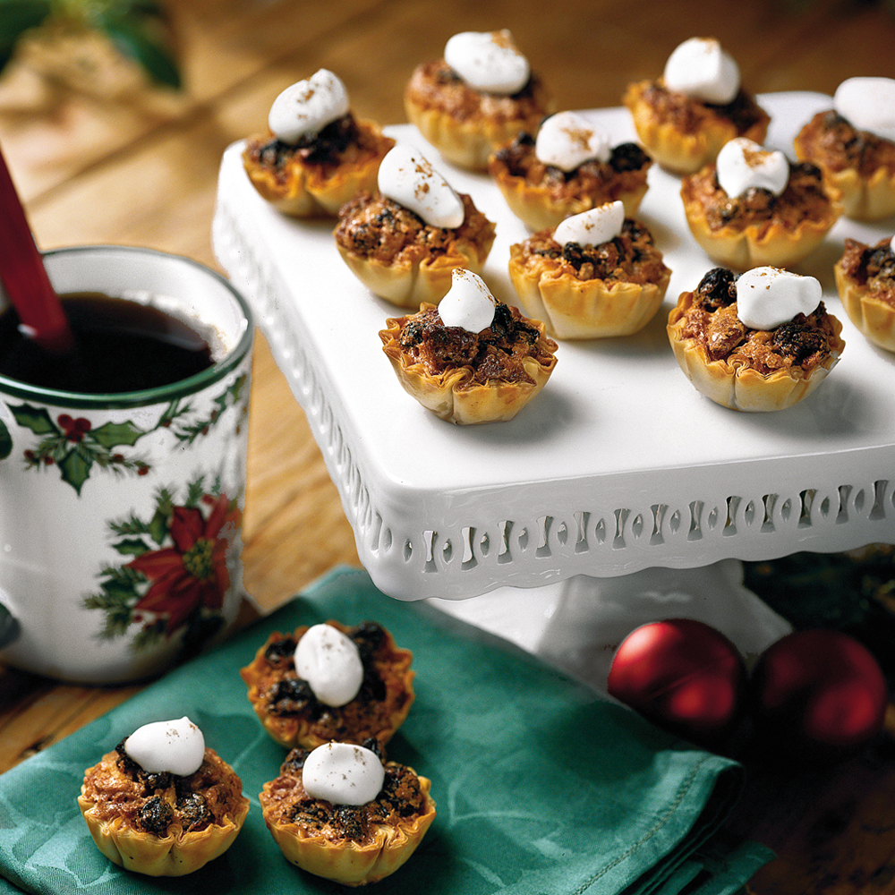 Pecan-Raisin Mini-Tarts RecipePecan pie is always a welcome treat during the holidays but is sometimes a bit messy to serve. With these little pecan tarts, there's no need for a fork since you can simply pick one up and pop it in your mouth. The raisins in the filling add a bit of extra sweetness.