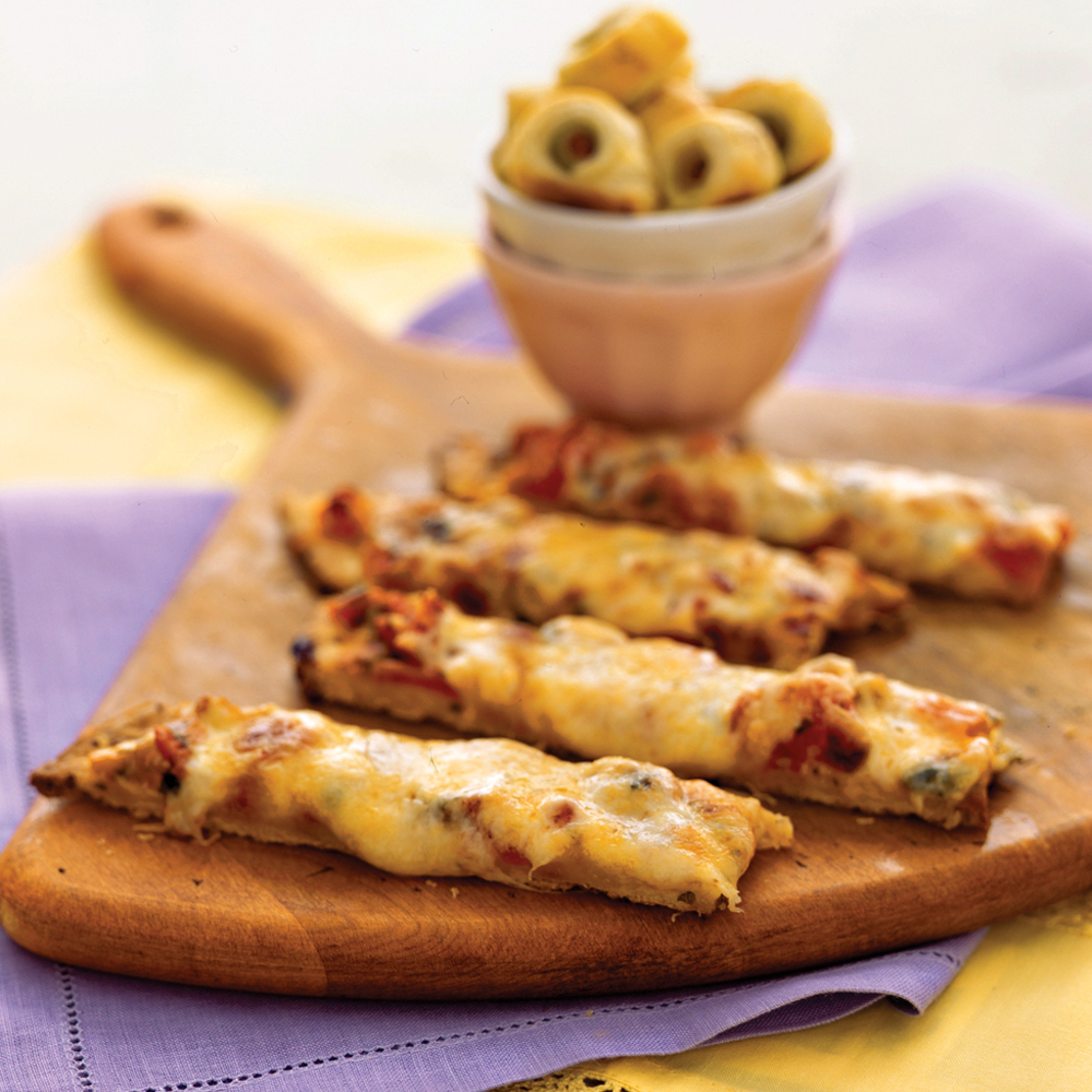 Pizza Sticks RecipeJarred bruschetta topping, chock full of flavorful herbs and veggies, saves both money and prep time for these cheesy pizza sticks.  Simply top a refrigerated thin pizza crust with the bruschetta topping and a shredded cheese blend, bake, and cut into bite-size strips.