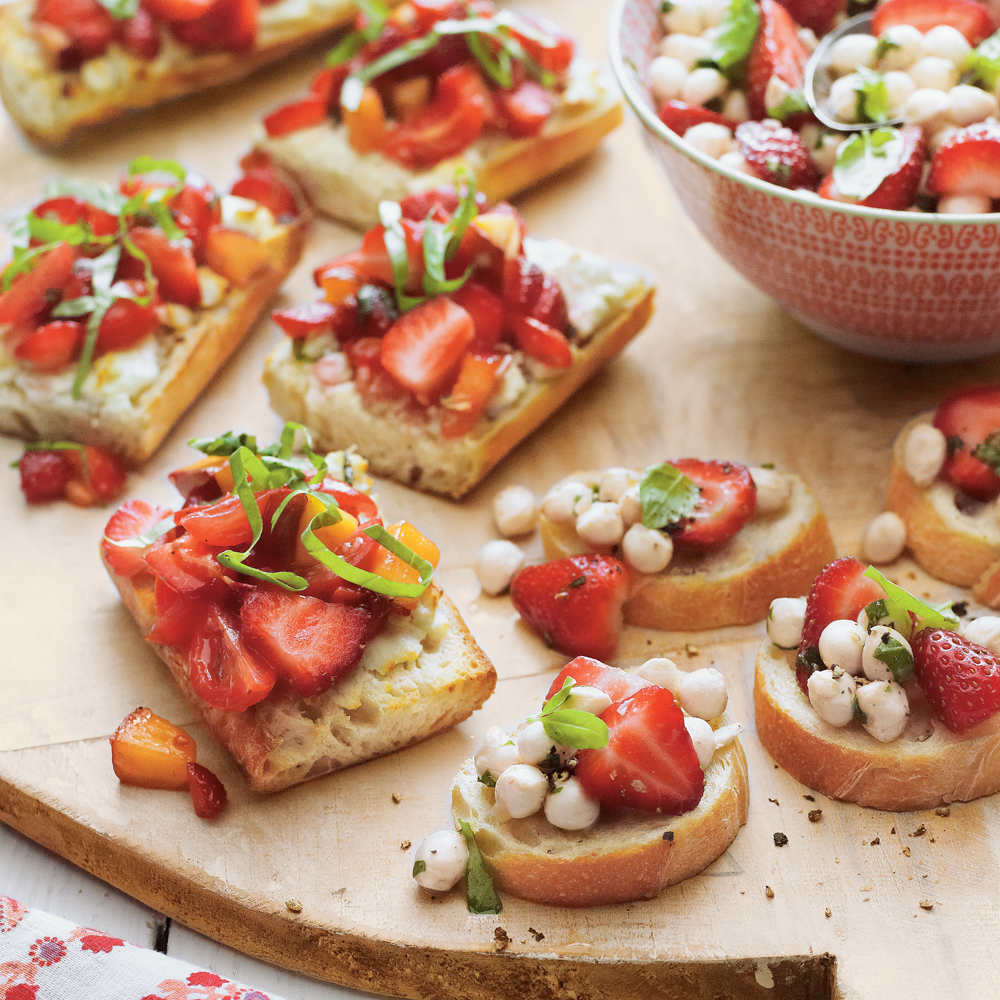 Strawberry Bruschetta RecipeUsher in the warm days of spring and summer with Strawberry Bruschetta. This refreshing mixture of  nectarine, grape tomatoes, strawberries, and basil are served over baguette slices with slatherings of goat cheese.