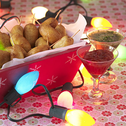 Corn Dogs RecipeMini sausages hand-battered and fried golden are just the right size for munching and mingling. Not to be left out of the tacky theme, we served them in a jolly basket with cheery red (ketchup) and green (salsa verde) condiments.