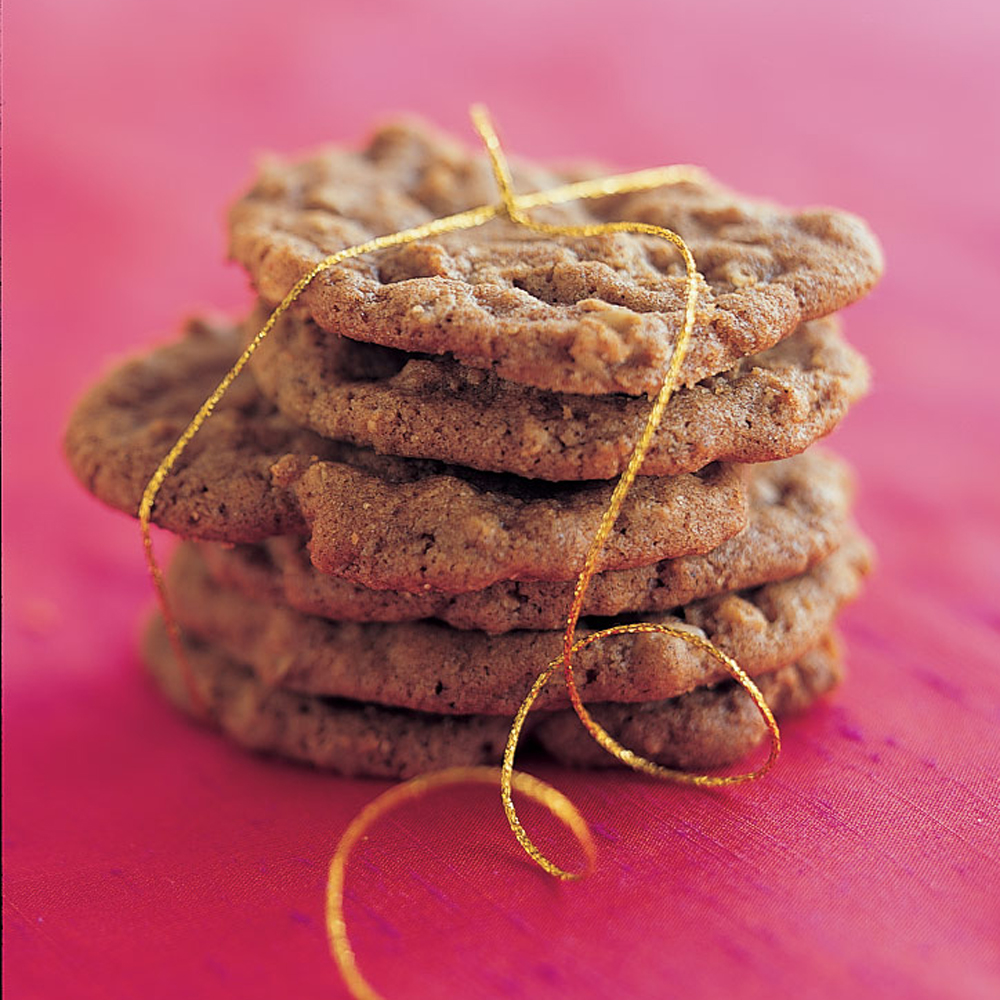 Spicy Oatmeal Crisps RecipeThese aren't your typical oatmeal cookies! Cinnamon, allspice, nutmeg, cloves and black pepper give these crispy cookies a wonderful kick. Line your pan with parchment paper to make it easier to remove the cookies.