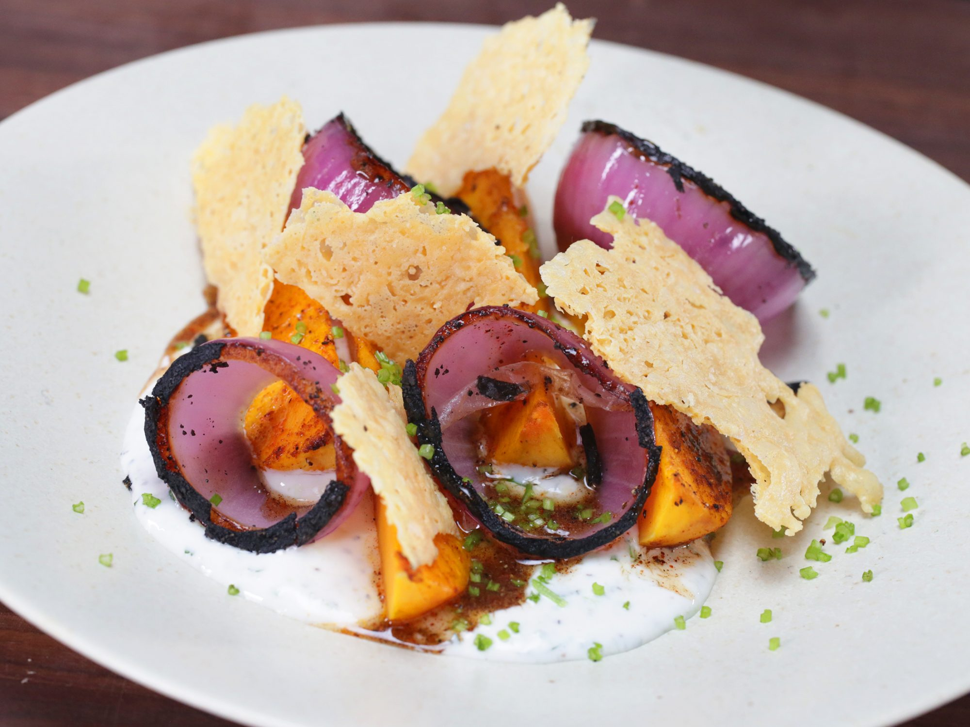 Roasted Winter Squash with Chipotle Honey, Tillamook Cheddar Crisp, Lime Yogurt, and Charred Onion