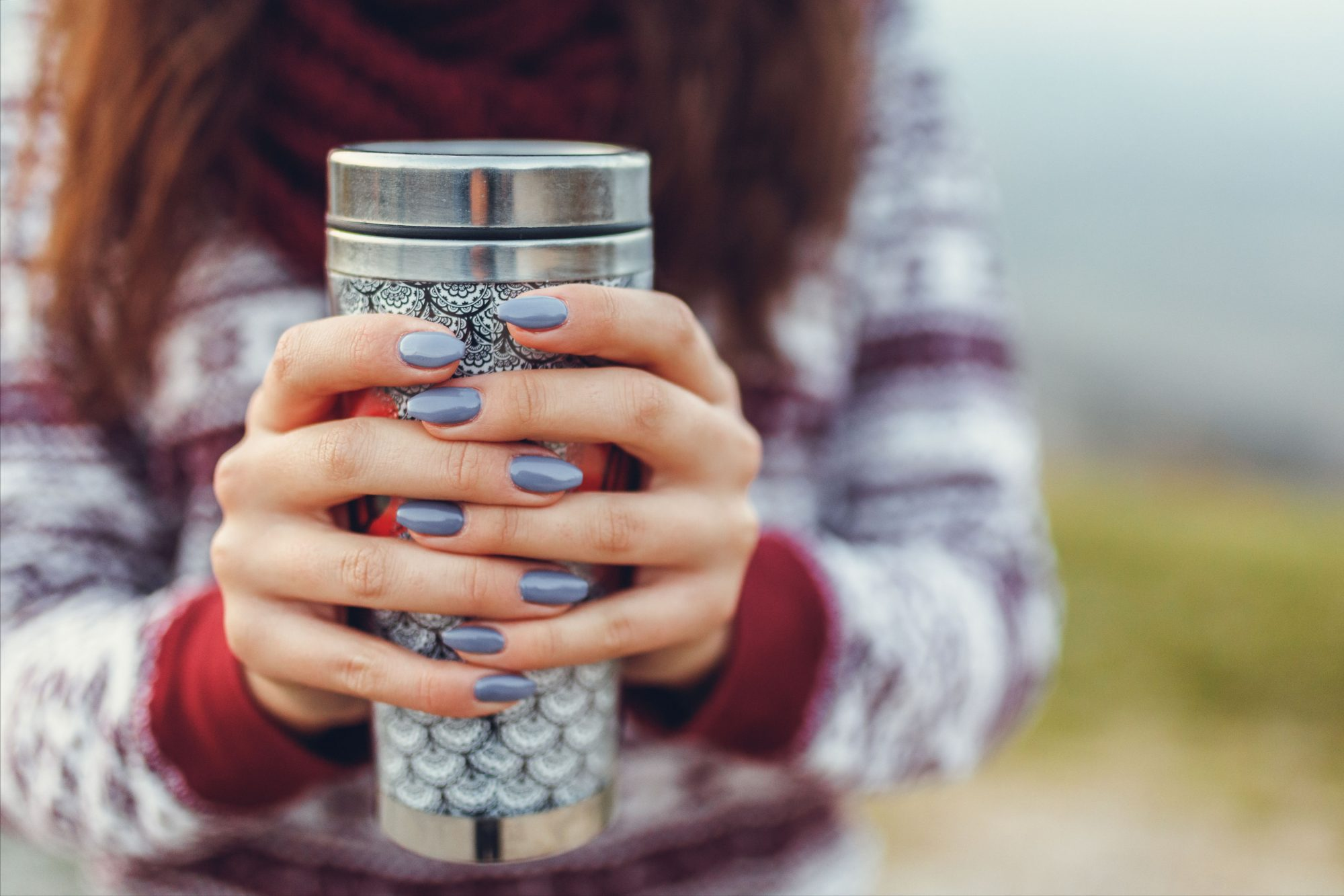 Woman Holding Travel Mug