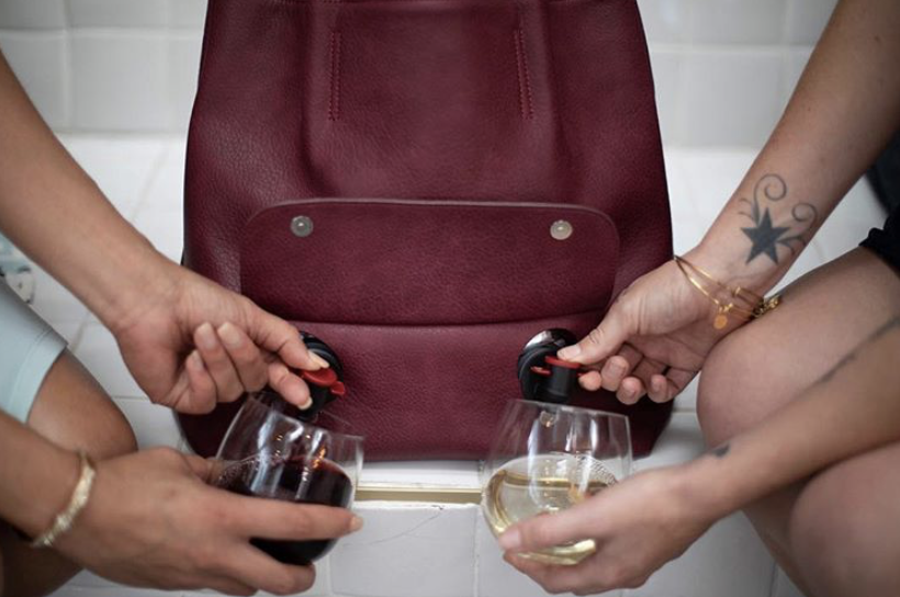 This Incredibly Classy Wine Purse Has Two Spouts