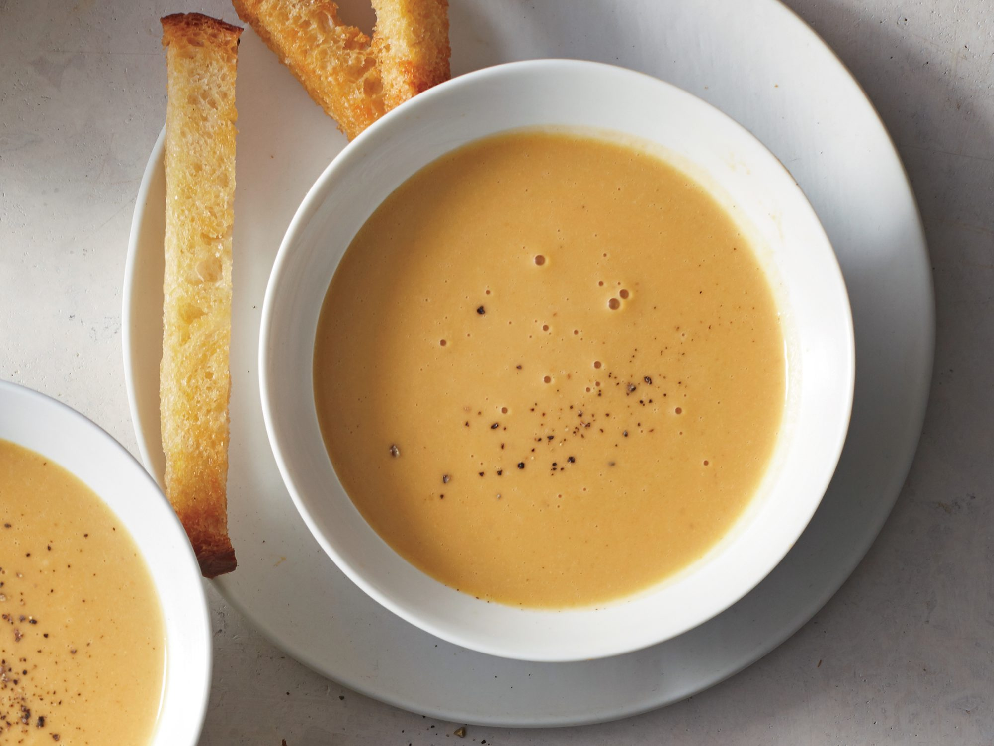Silky Garlic Soup with Sourdough Soldiers