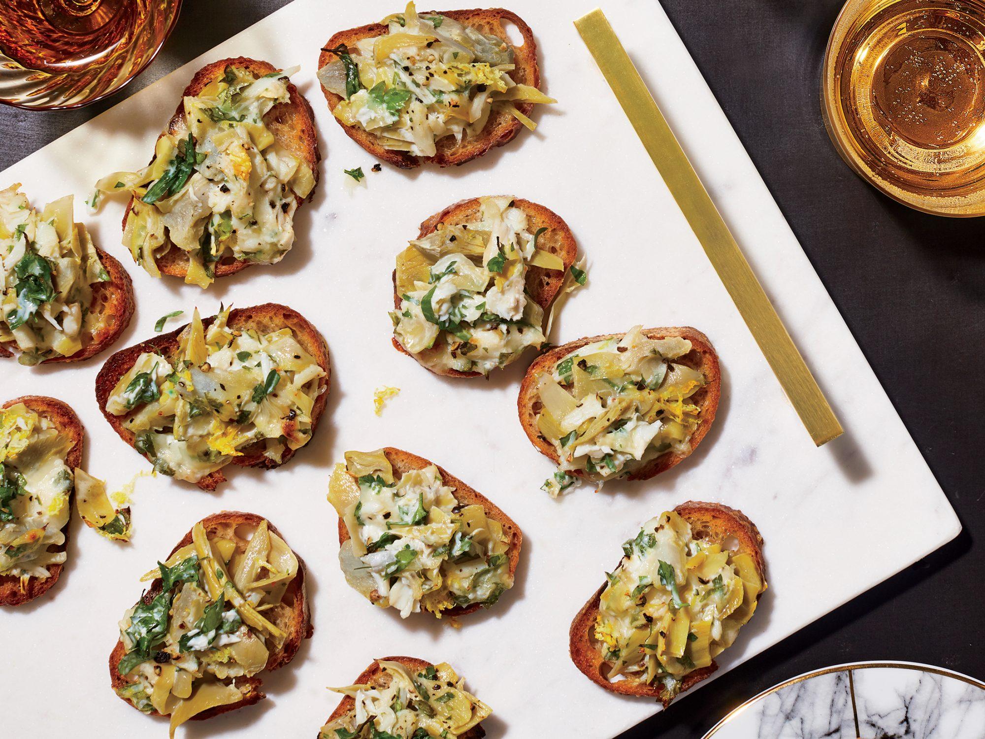 Cheesy Crab Artichoke Toasts