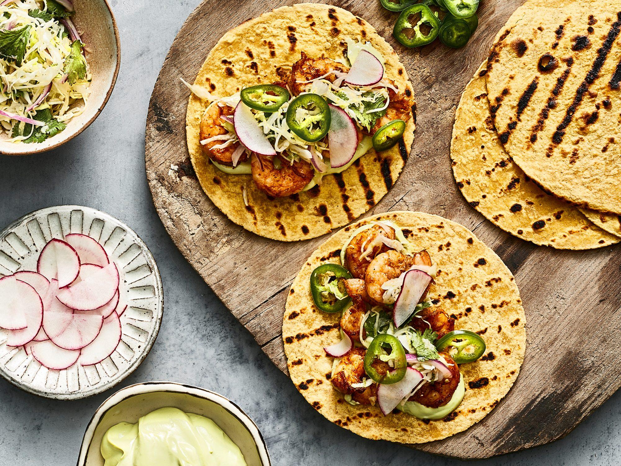 Shrimp Tacos With Cilantro Lime Slaw And Avocado Crema image