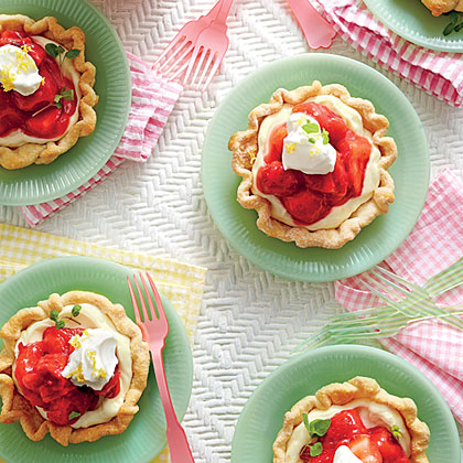 Mile-High Mini Strawberry Pies RecipeWhat's cuter than a strawberry pie? A mini strawebrry pie heaped with vanilla cream.