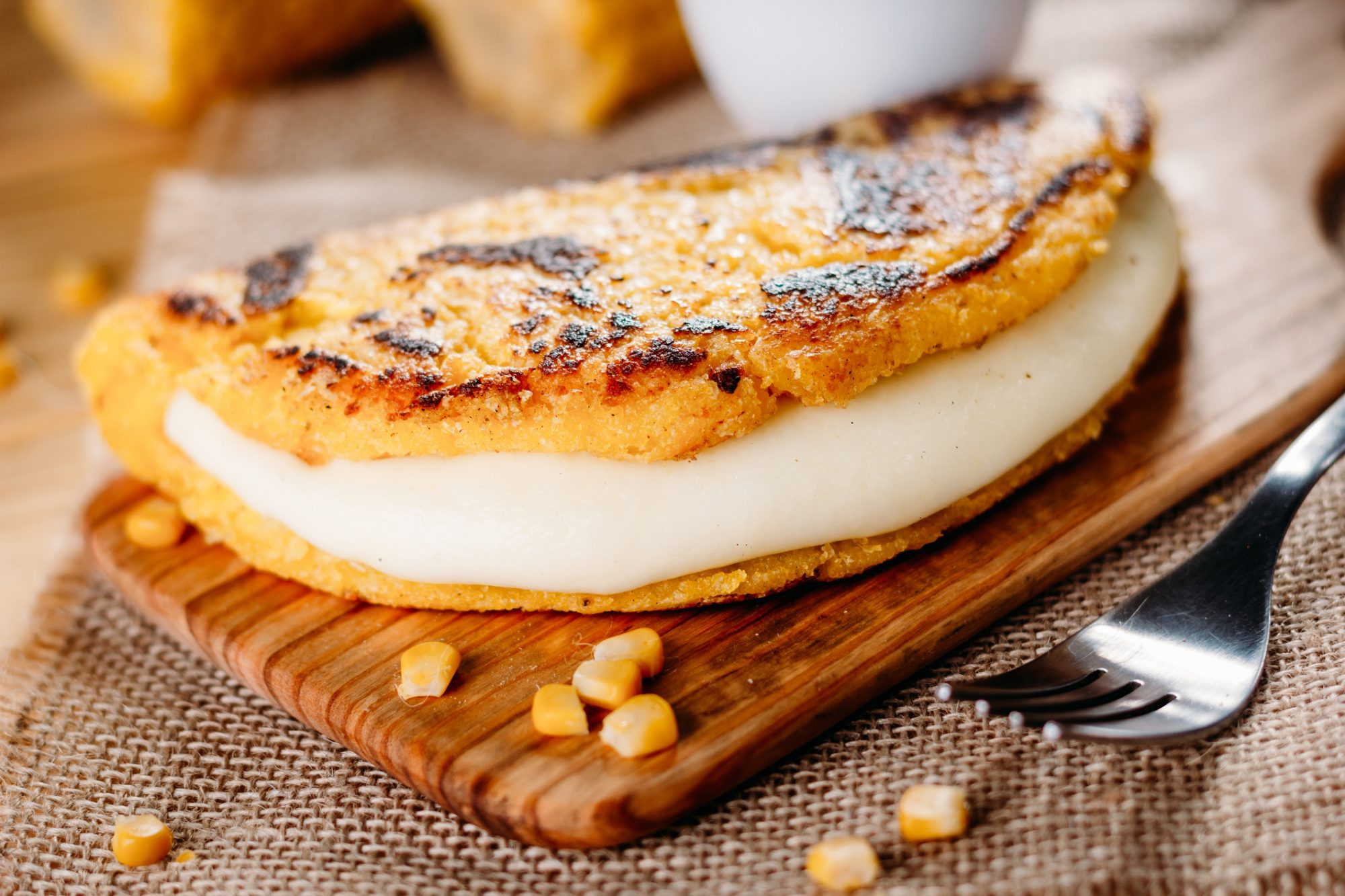 Why You Should Make Cachapas, Venezuelan Corn Pancakes Stuffed With Cheese