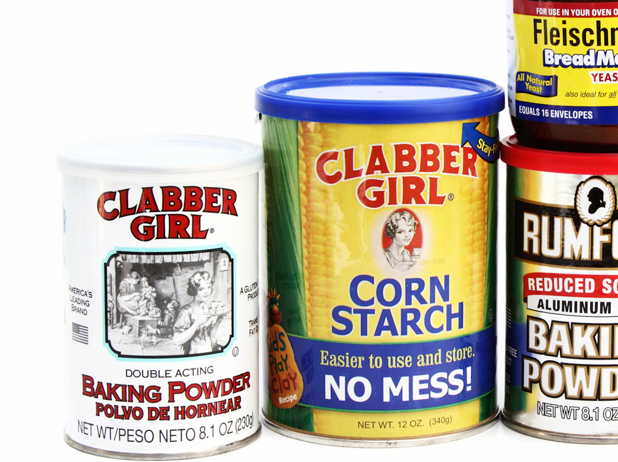 <p>West Palm Beach, USA - December 4, 2014: Studio shot of an assortment of cooking or baking ingredients, including Clabber Girl Baking Powder and Corn Starch, Rumford Baking Powder, Fleischmann's Yeast, and McCormick Black Pepper.</p>