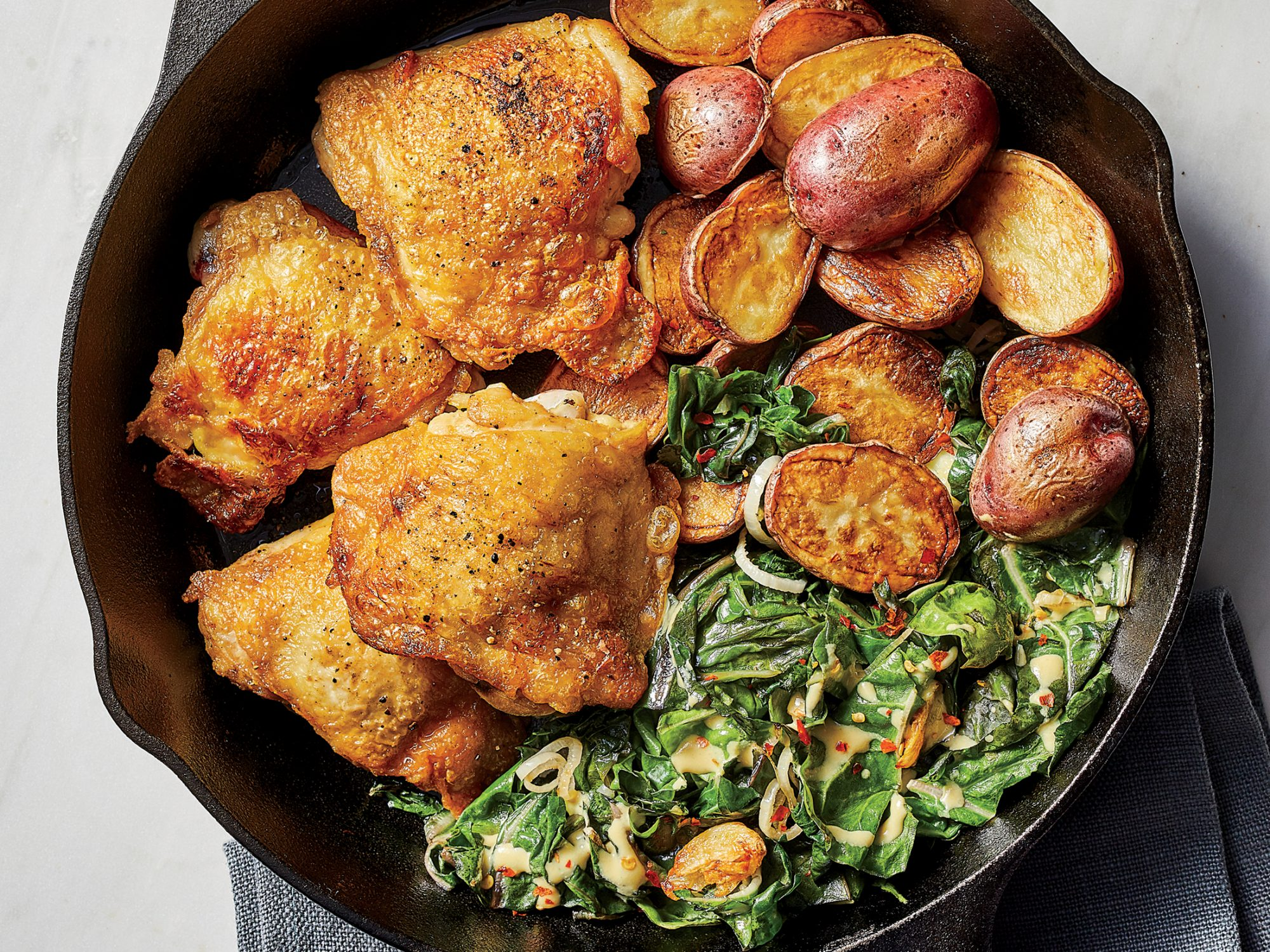 Extra-Crispy Chicken Thighs with Potatoes and Chard