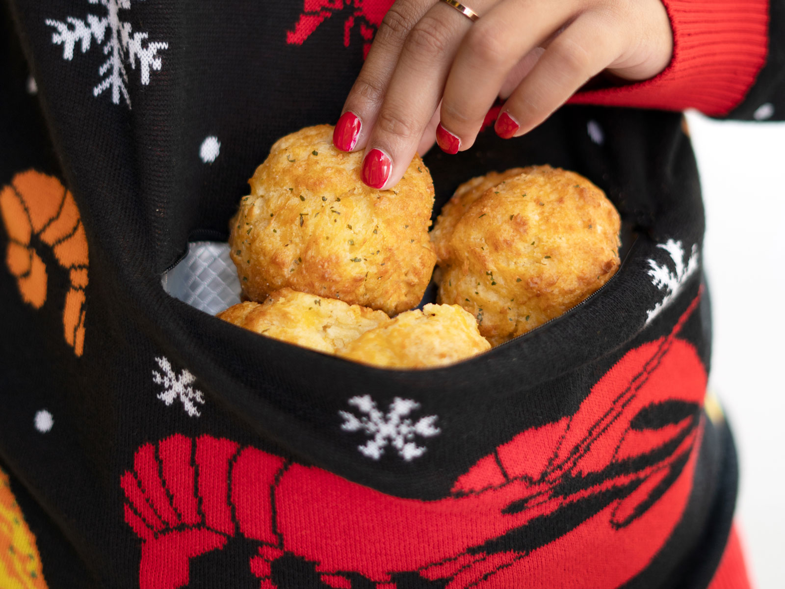 Red Lobster's Ugly Sweater Has a Cheddar Bay Biscuit Pocket red-lobster-sweater-FT-BLOG1119