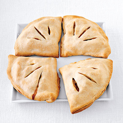 Chicken Potpie Empanadas RecipeThis recipe combines convenient store-bought rotisserie chicken with a rich and creamy potpie base. Rather than topped with a flaky crust, this potpie is stuffed in a piecrust, making it a true empanada.
