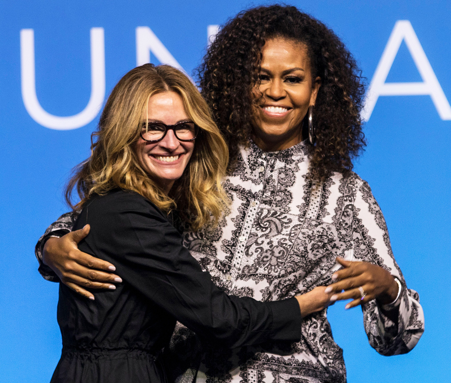 Former US first lady Michelle Obama (R) hugs US actress Julia Roberts at the end of an Obama Foundation event in Kuala Lumpur, Malaysia, 12 December 2019. Obama Foundation event in Kuala Lumpur, Malaysia - 12 Dec 2019