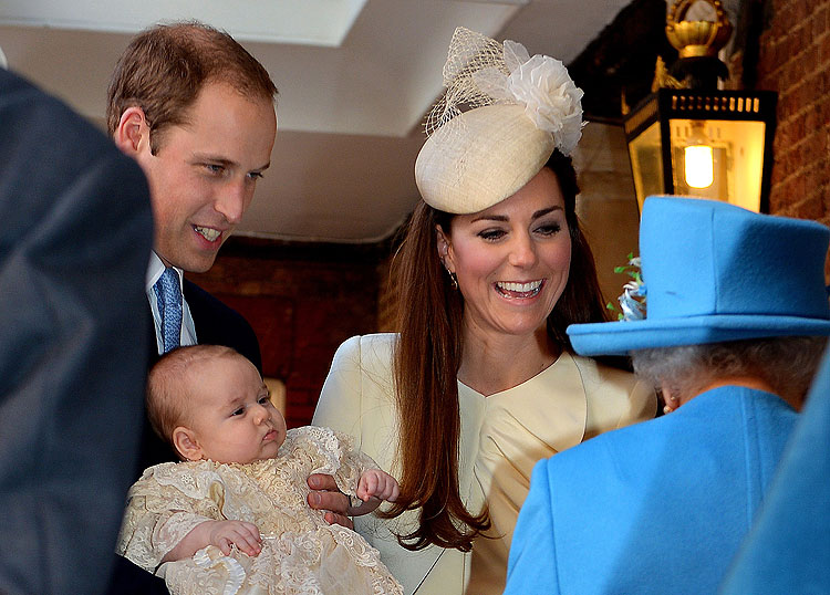 Britain's Prince William, Duke of Cambridge and his wife Catherine, Duchess of Cambridge, speak with Queen Elizabeth II as they hold their son Prince George of Cambridge at Chapel Royal in St James's Palace in central London on October 23, 2013, upon arri