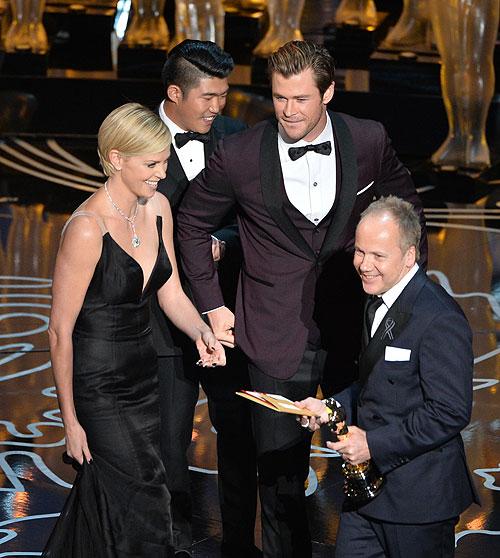 Glenn Freemantle, Charlize Theron, Chris Hemsworth, Gala Premios Óscar 2014