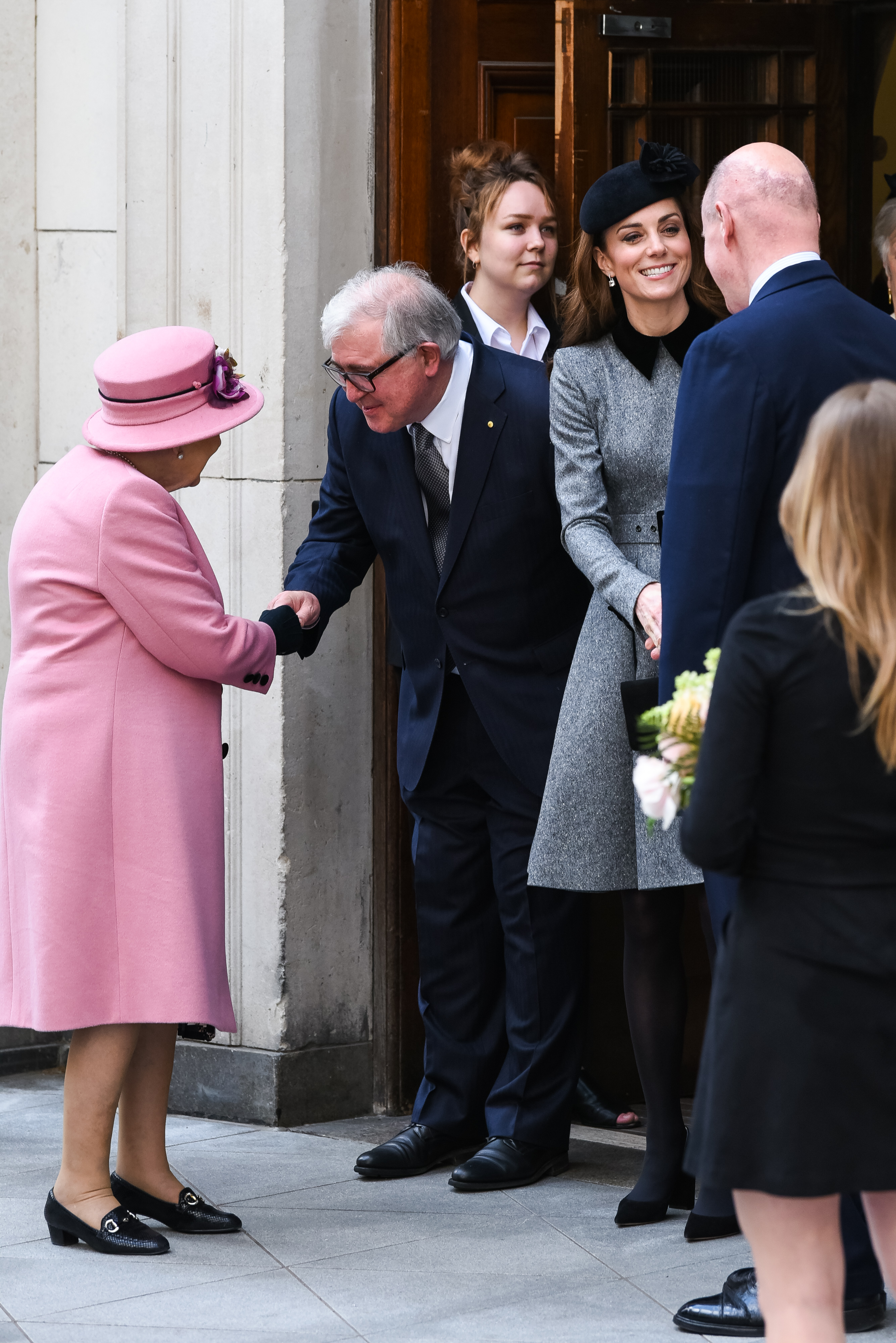 Queen Elizabeth II accompanied by and Catherine, Duchess of Cambridge Visit King's College London