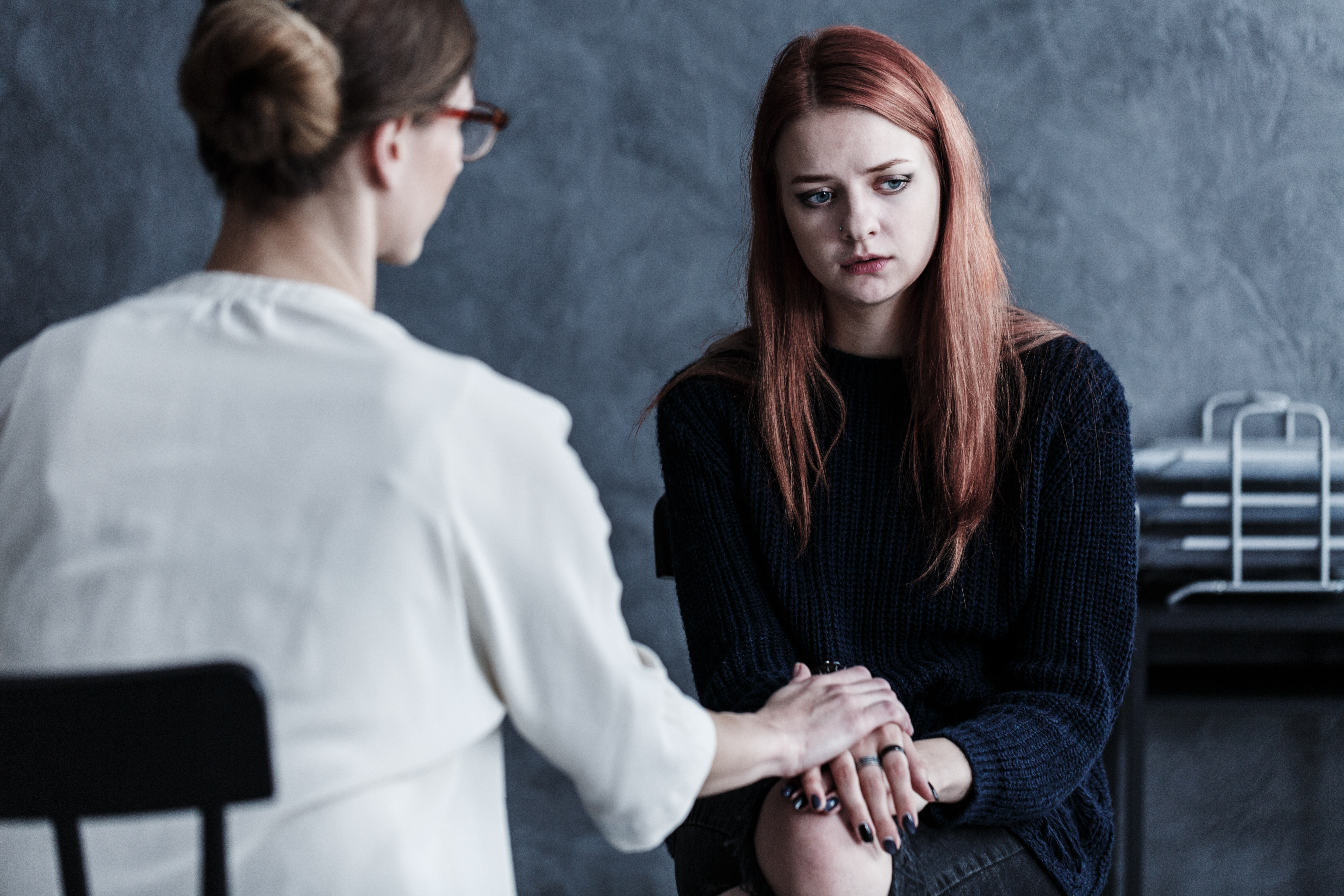 Therapist looking after her patient